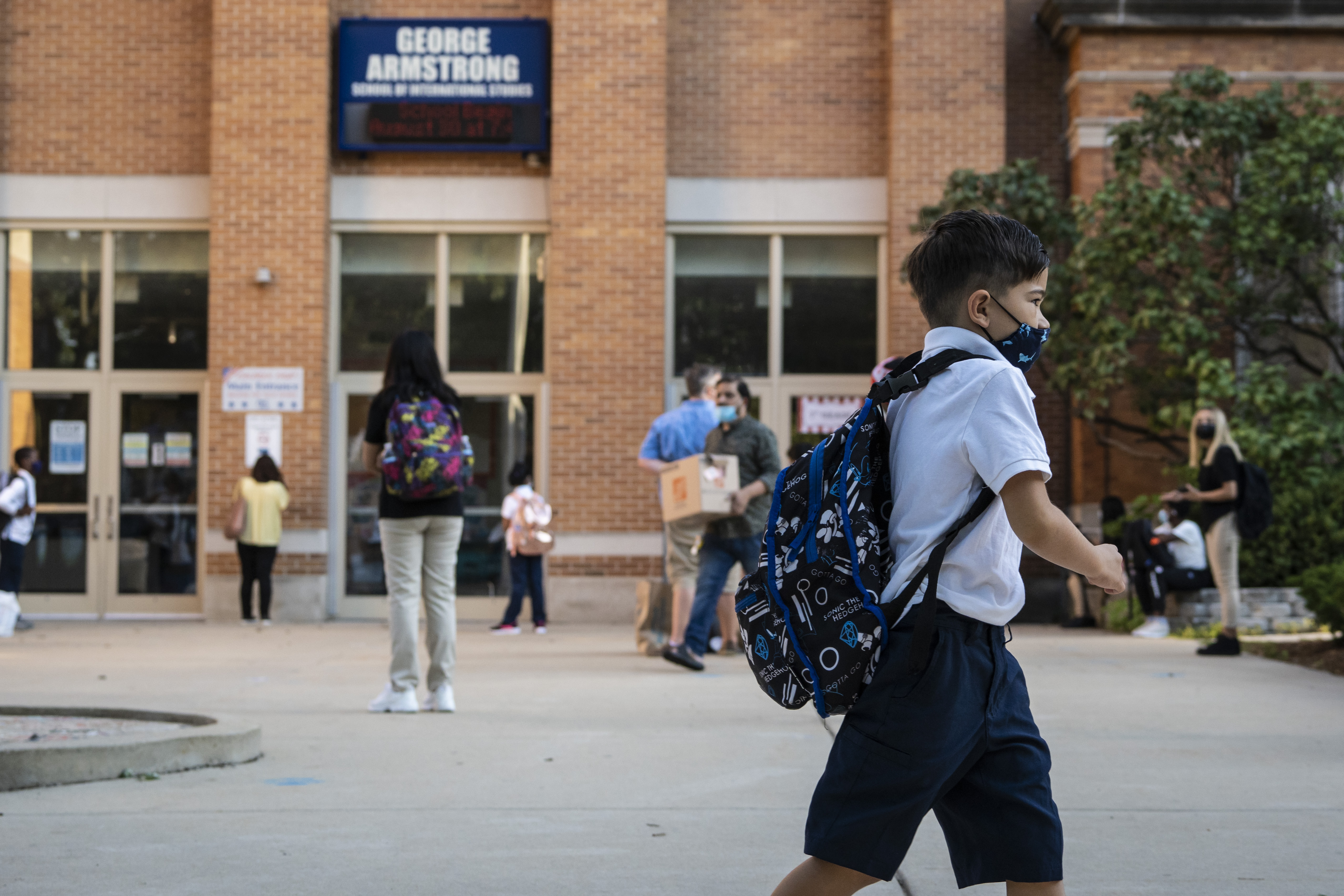 Parents and students arrive at George Armstrong Elementary School, 2110 W. Greenleaf Ave. in Rogers Park, for the first day of school for Chicago Public Schools, Monday morning, Aug. 30, 2021.