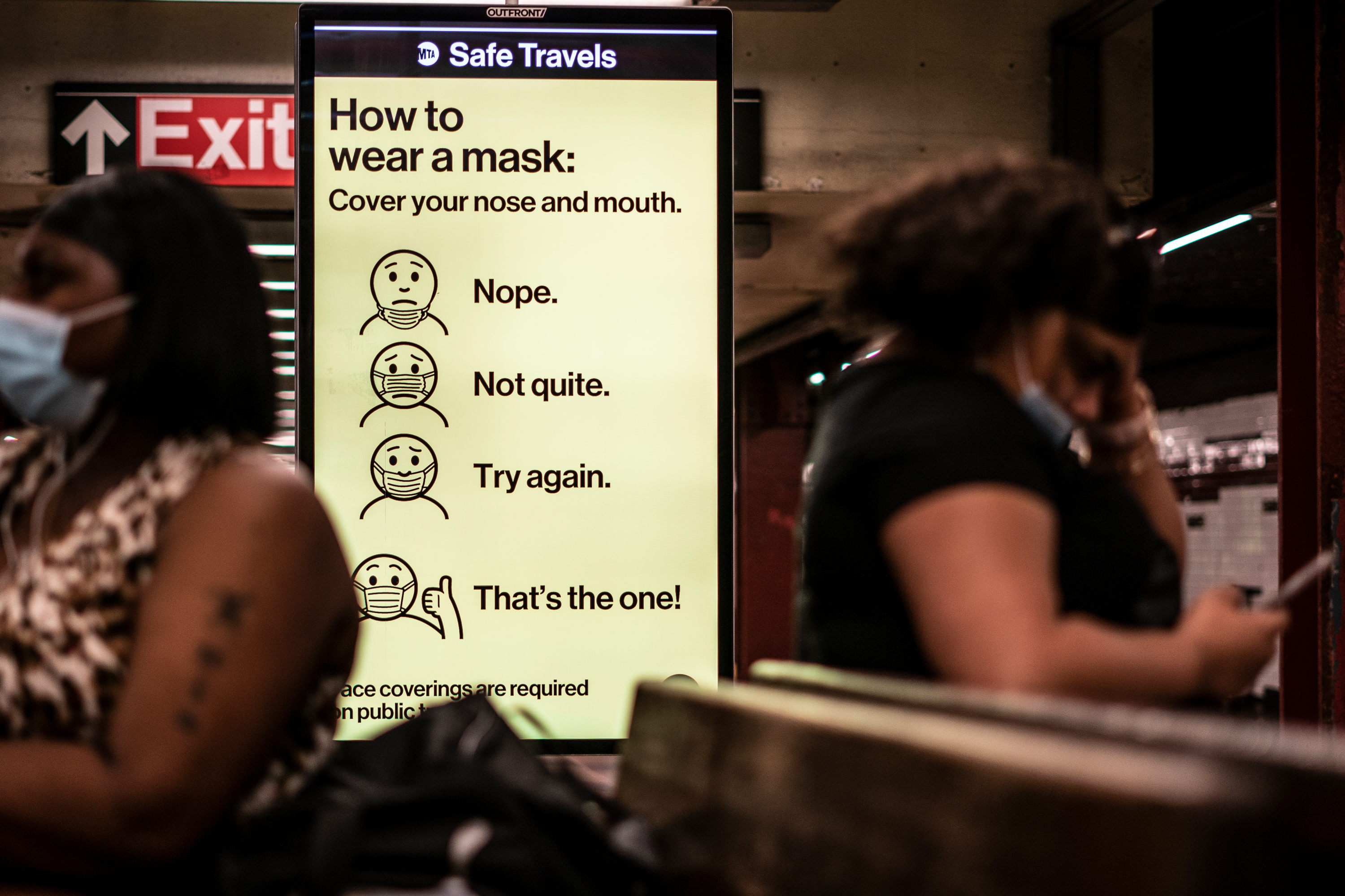 Cheeky signage in the subways, here at the Utica Ave. station, illustrates how to properly cover your mouth and nose.