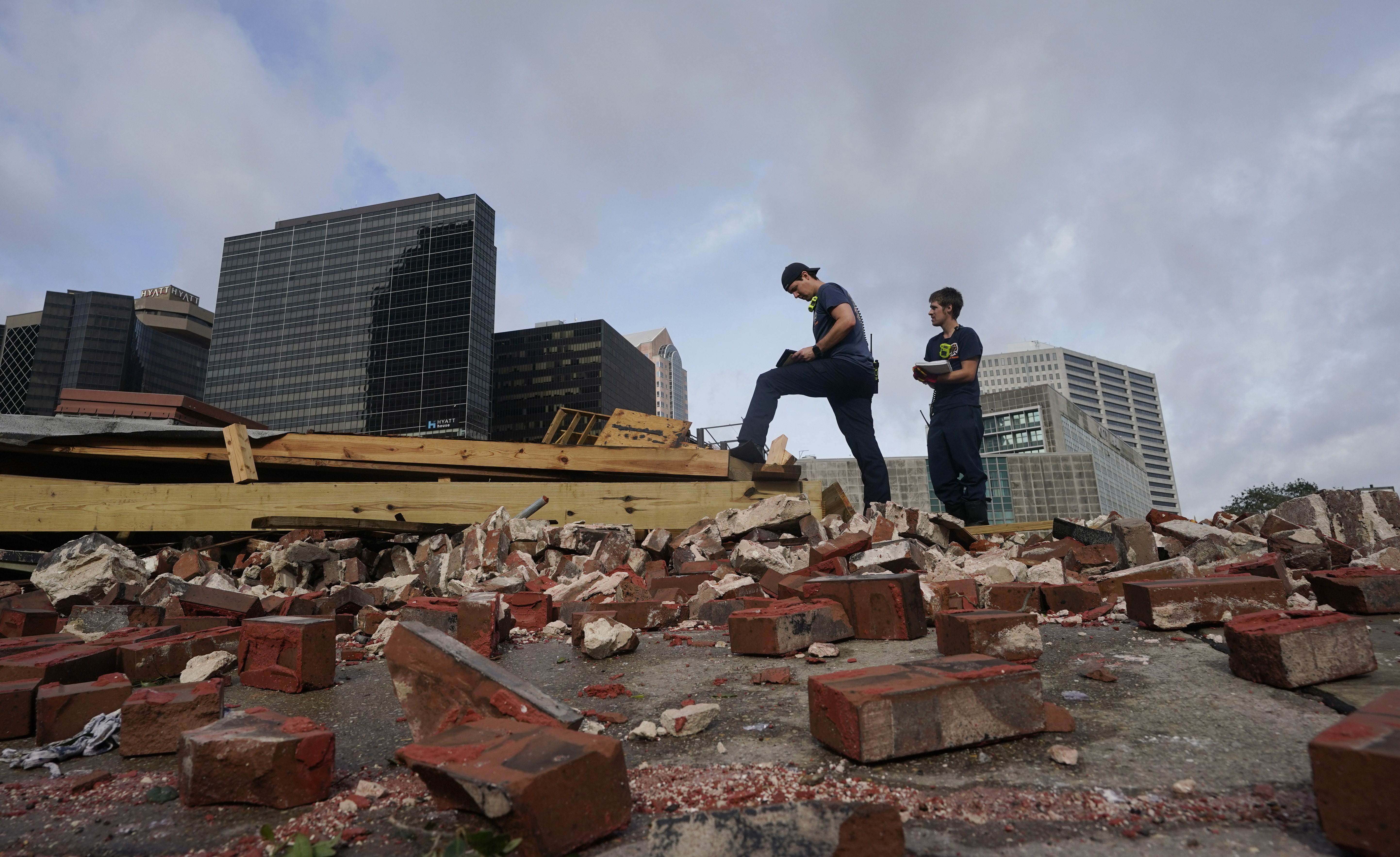 New Orleans firefighters assess damage after a building collapsed from the effects of Hurricane Ida, in New Orleans, La.