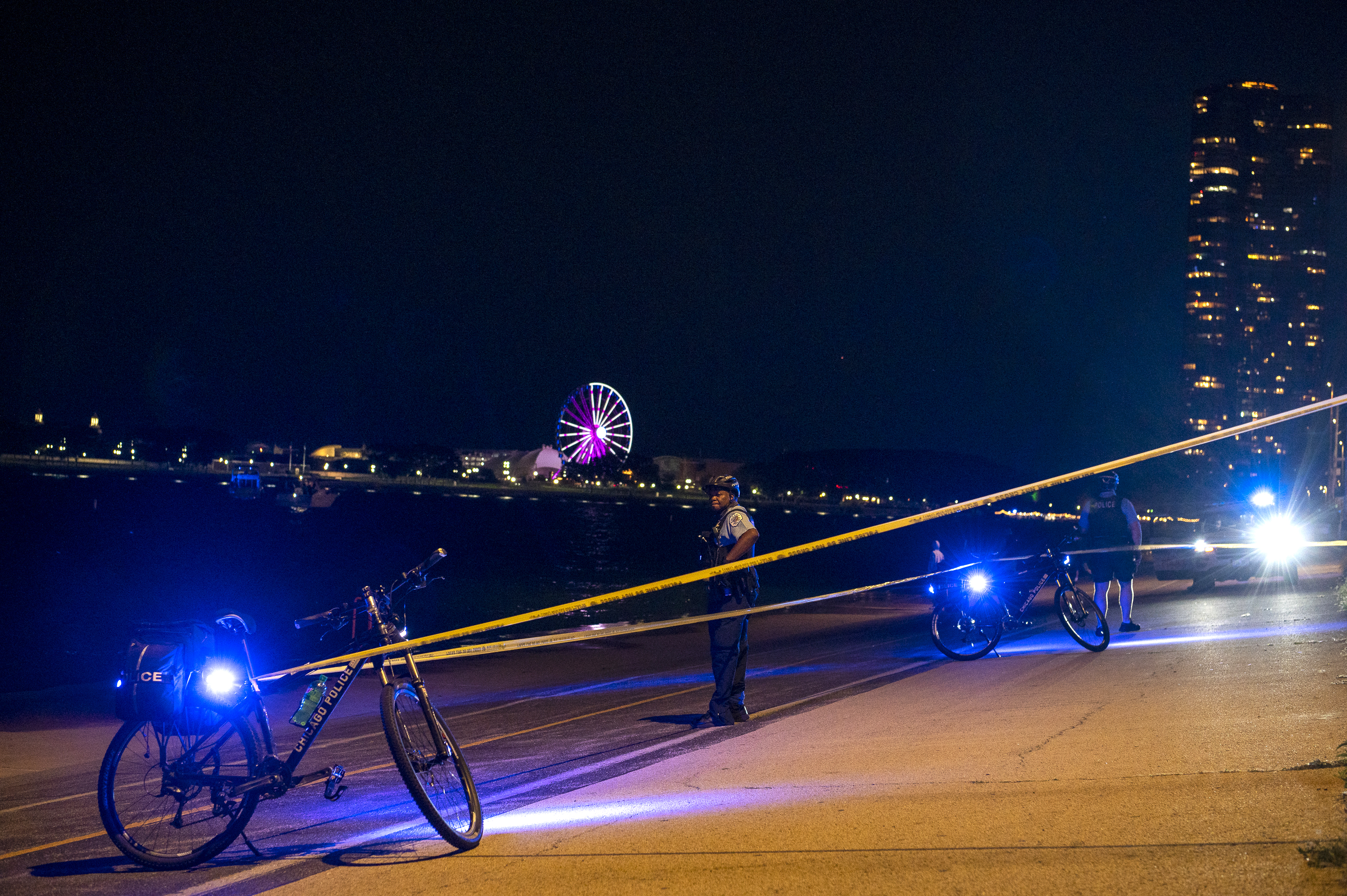 Crime scene tape blocks off a portion of the Lakefront Trail near the 800 block of North Lake Shore Drive, where a man was shot Monday evening in the Gold Coast.