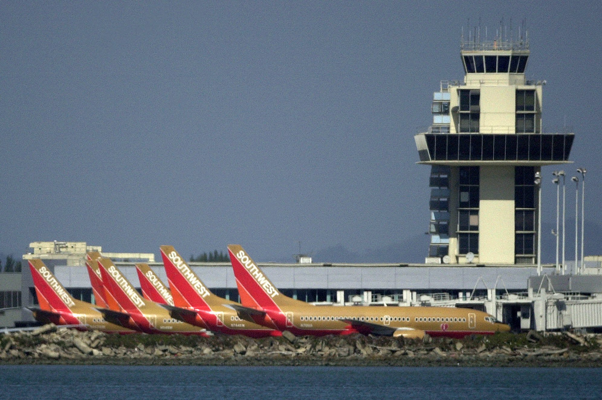 Southwest planes are seen parked beside the Oakland International Airport tower on Sept. 11, 2001, in Oakland, Calif.