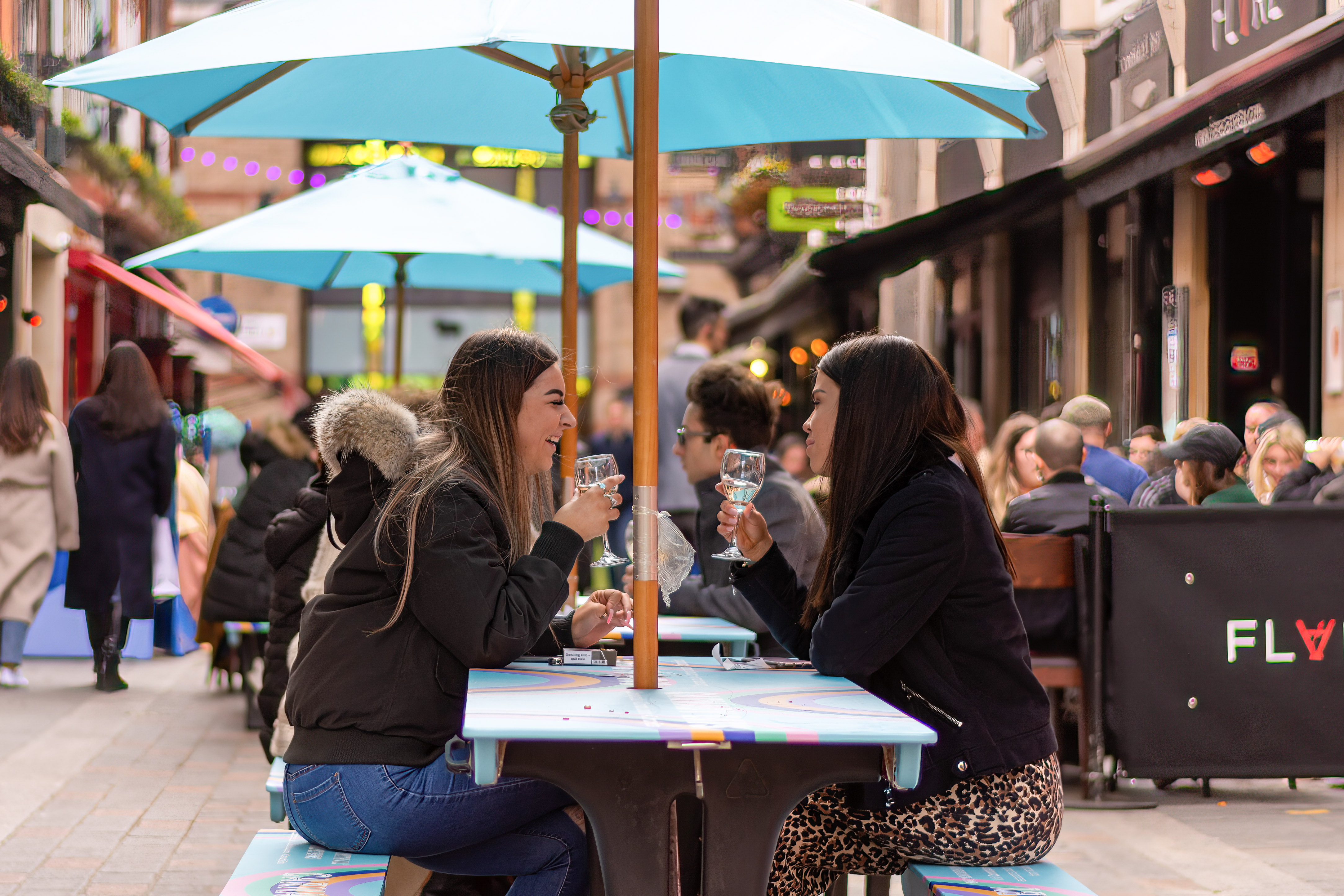 People enjoying food and drinks in Carnaby Street area.