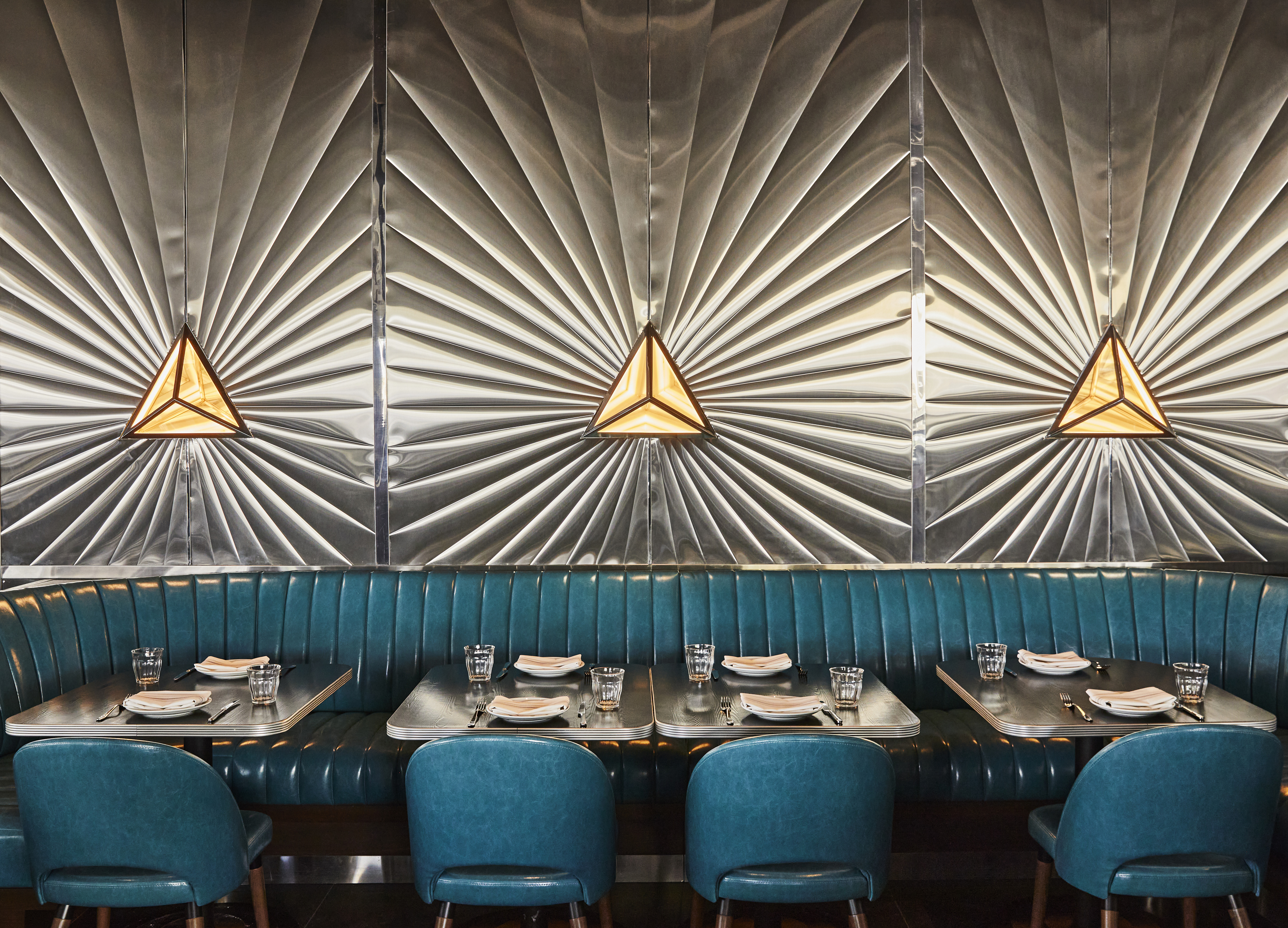 bright teal seating with sunburst meatal walls