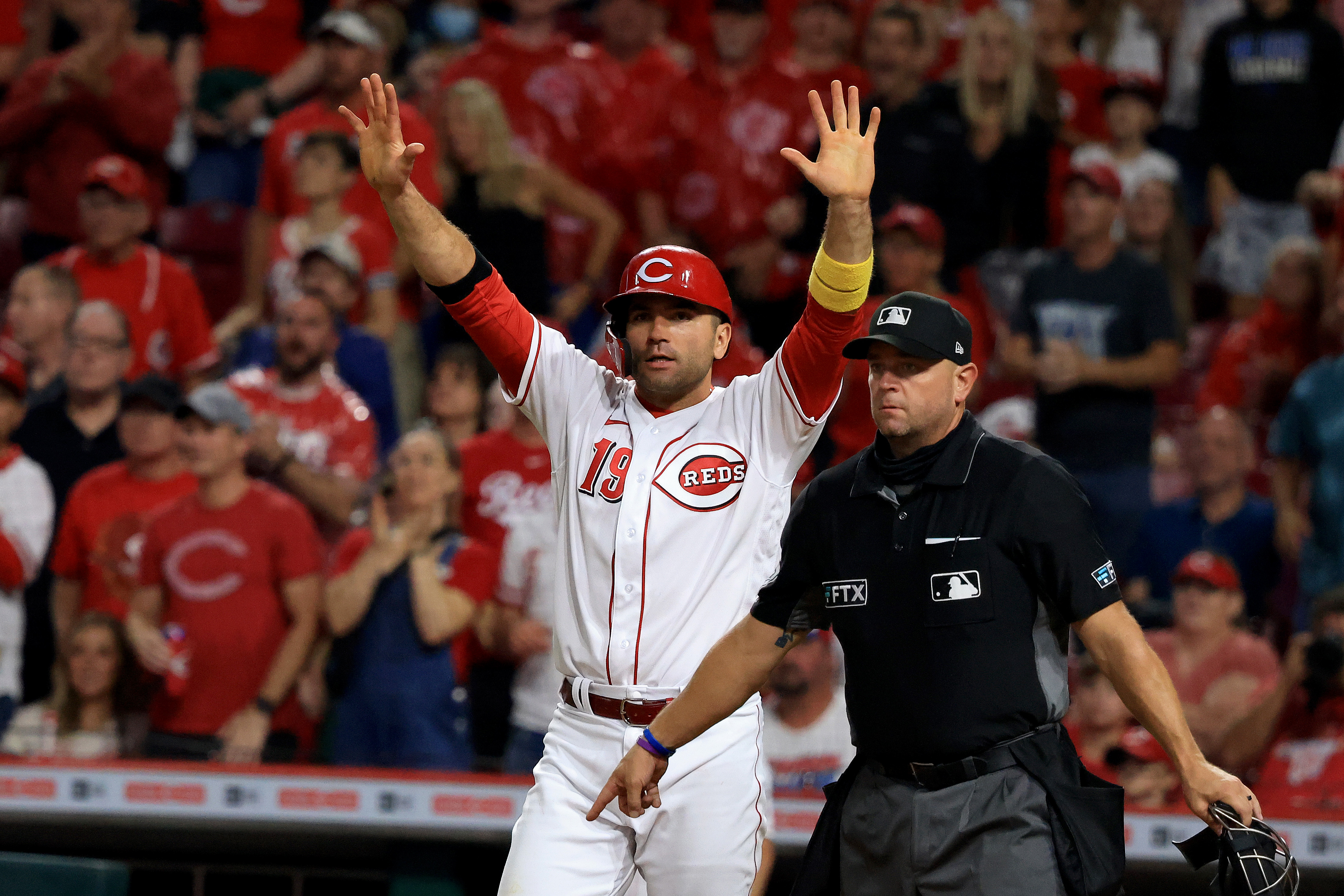 Joey Votto of the Cincinnati Reds directs his teammates during the seventh inning in the game against the Detroit Tigers at Great American Ball Park on September 04, 2021 in Cincinnati, Ohio.