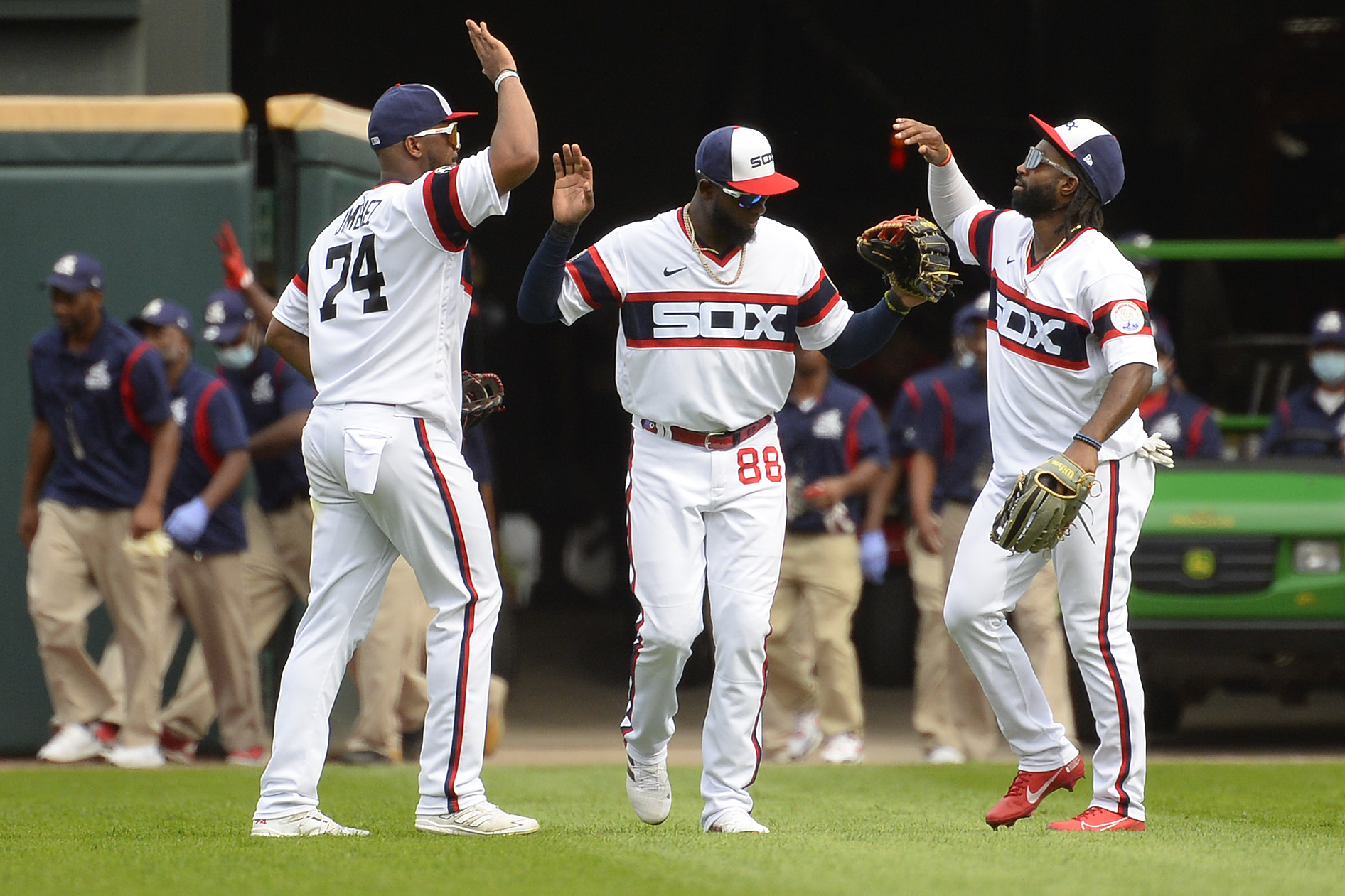 Eloy Jimenez, Luis Robert and Brian Goodwin of the Chicago White Sox celebrate after the game against the Chicago Cubs on August 29, 2021 at Guaranteed Rate Field in Chicago, Illinois.