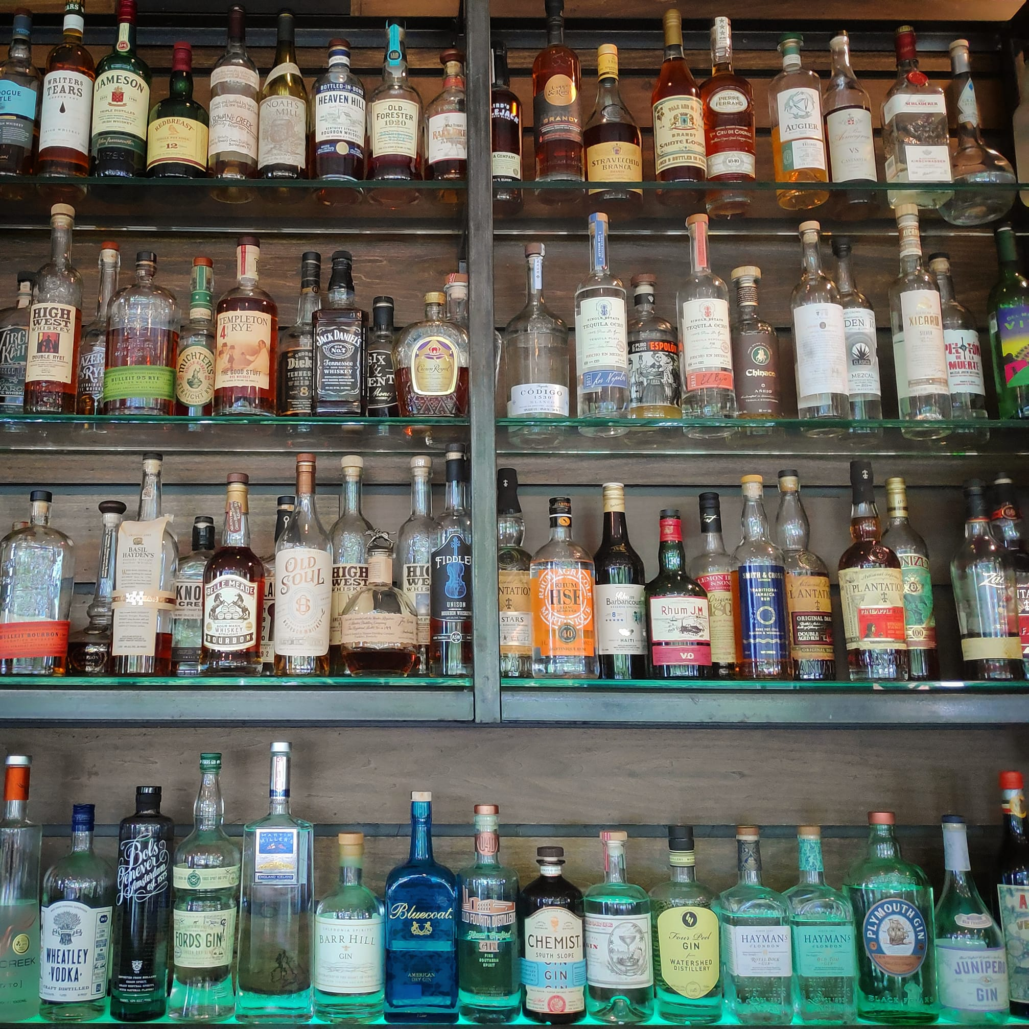 The back bar filled with liquor bottles at Ration and Dram (soon to be Dead End Drinks) in Kirkwood, atlanta