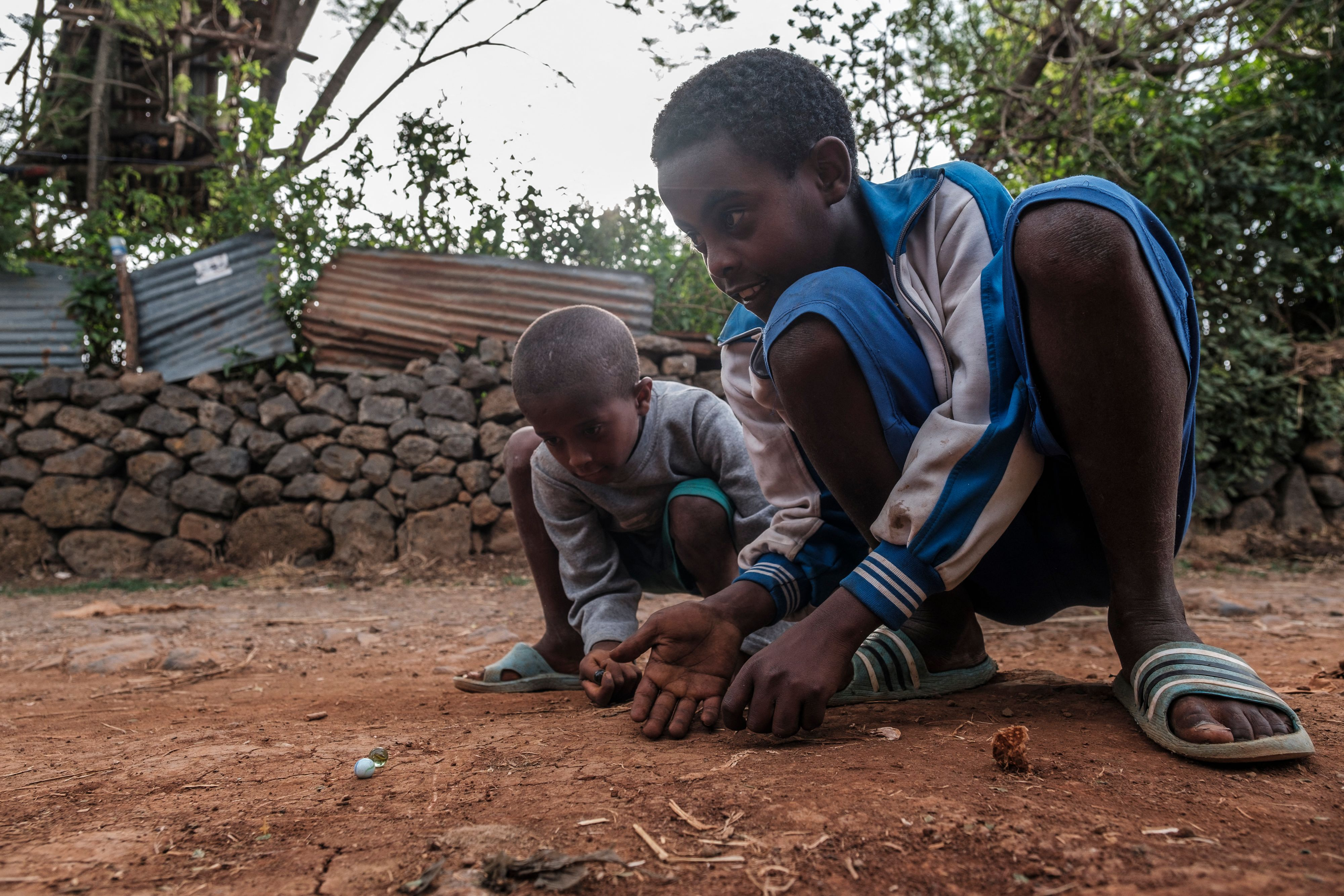 Actually children in Ethiopia playing marbles, but we're all about using our imagination here.