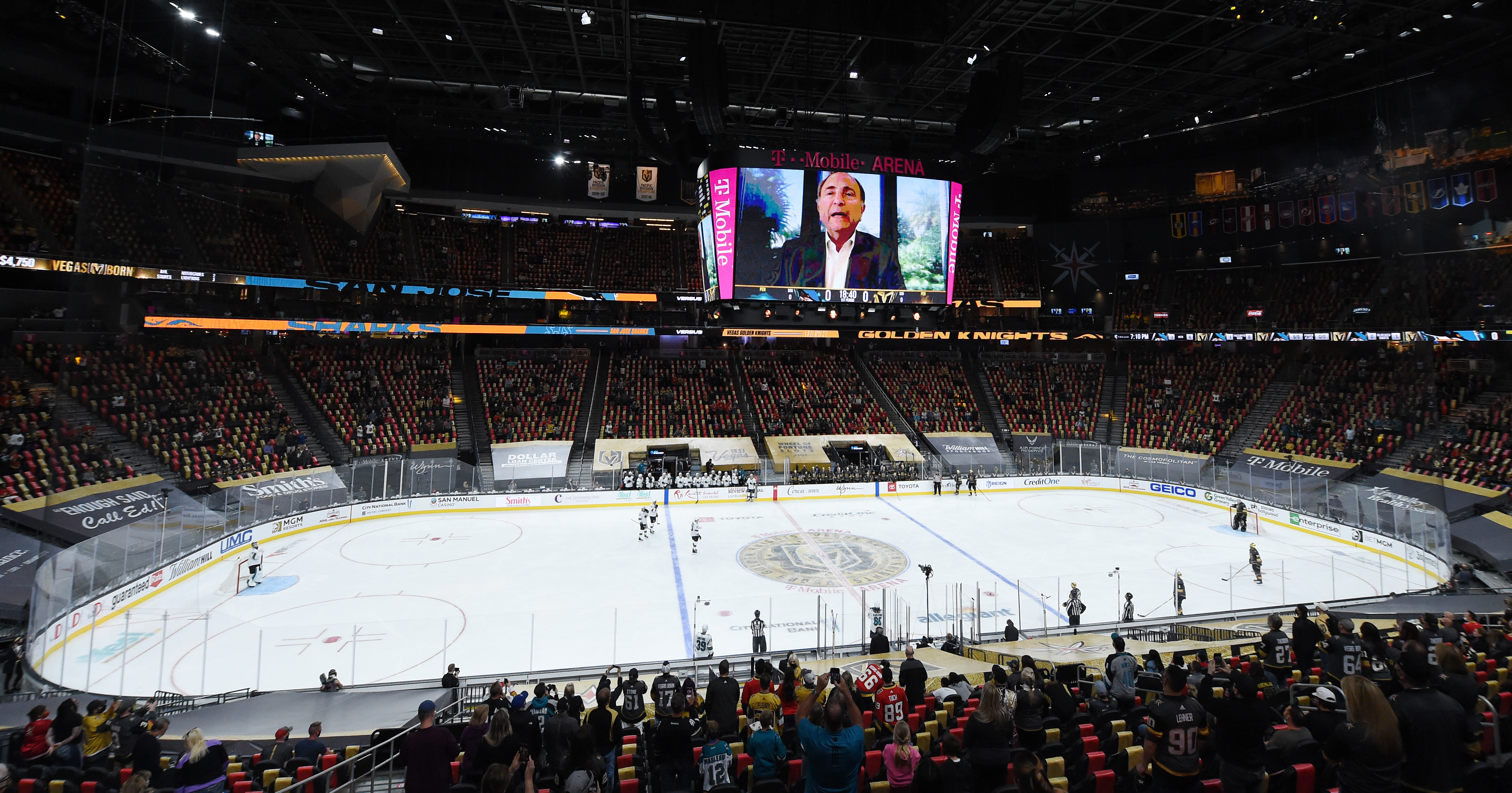 NHL Commissioner Gary Bettman is shown on a video honoring Patrick Marleau #12 of the San Jose Sharks during a break in the first period of a game against the Vegas Golden Knights, Marleau's 1,768th NHL game, at T-Mobile Arena on April 19, 2021 in Las Vegas, Nevada.