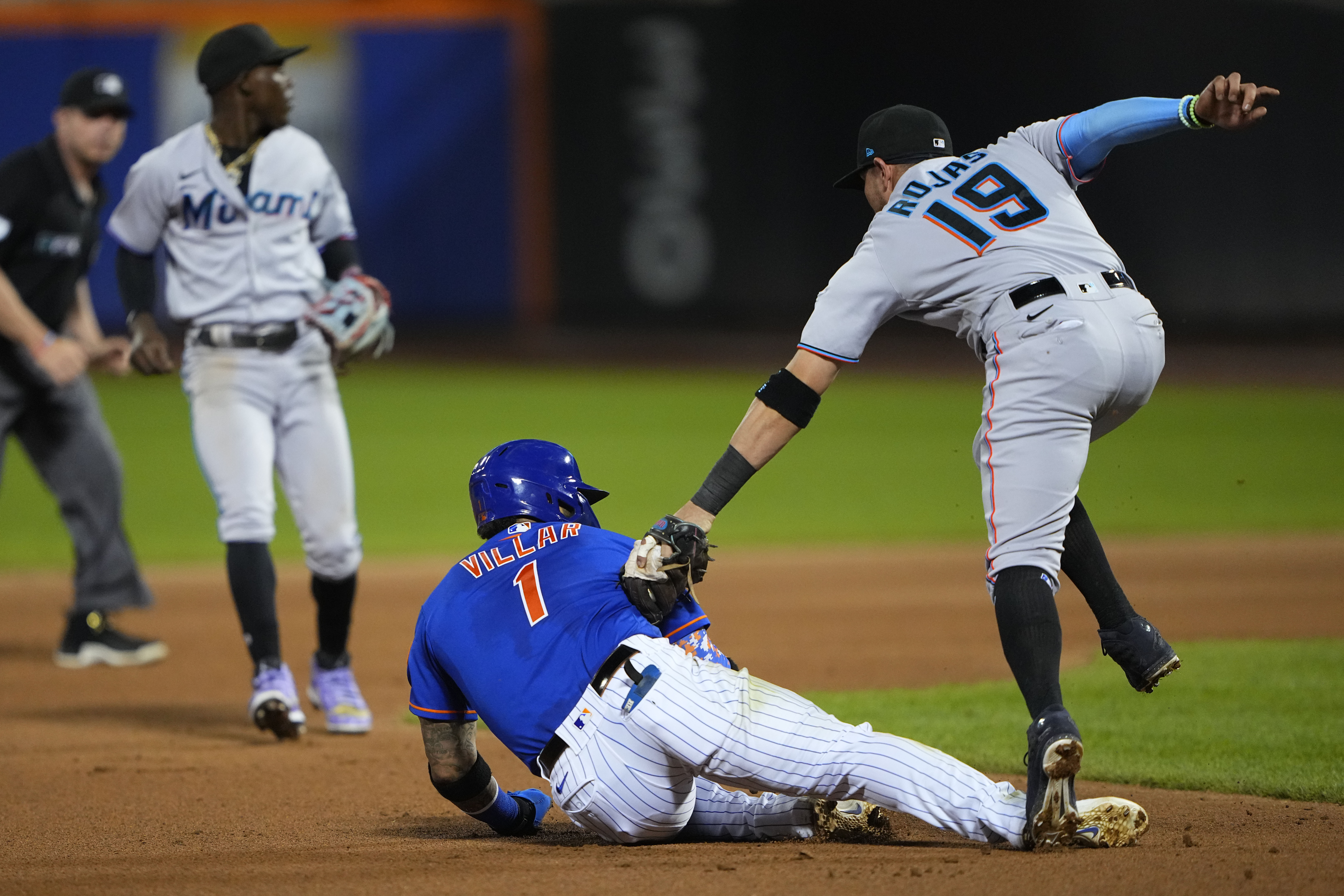 Miami Marlins shortstop Miguel Rojas (19) tags out New York Mets second baseman Jonathan Villar (1) on a fielders choice during the fourth inning at Citi Field.