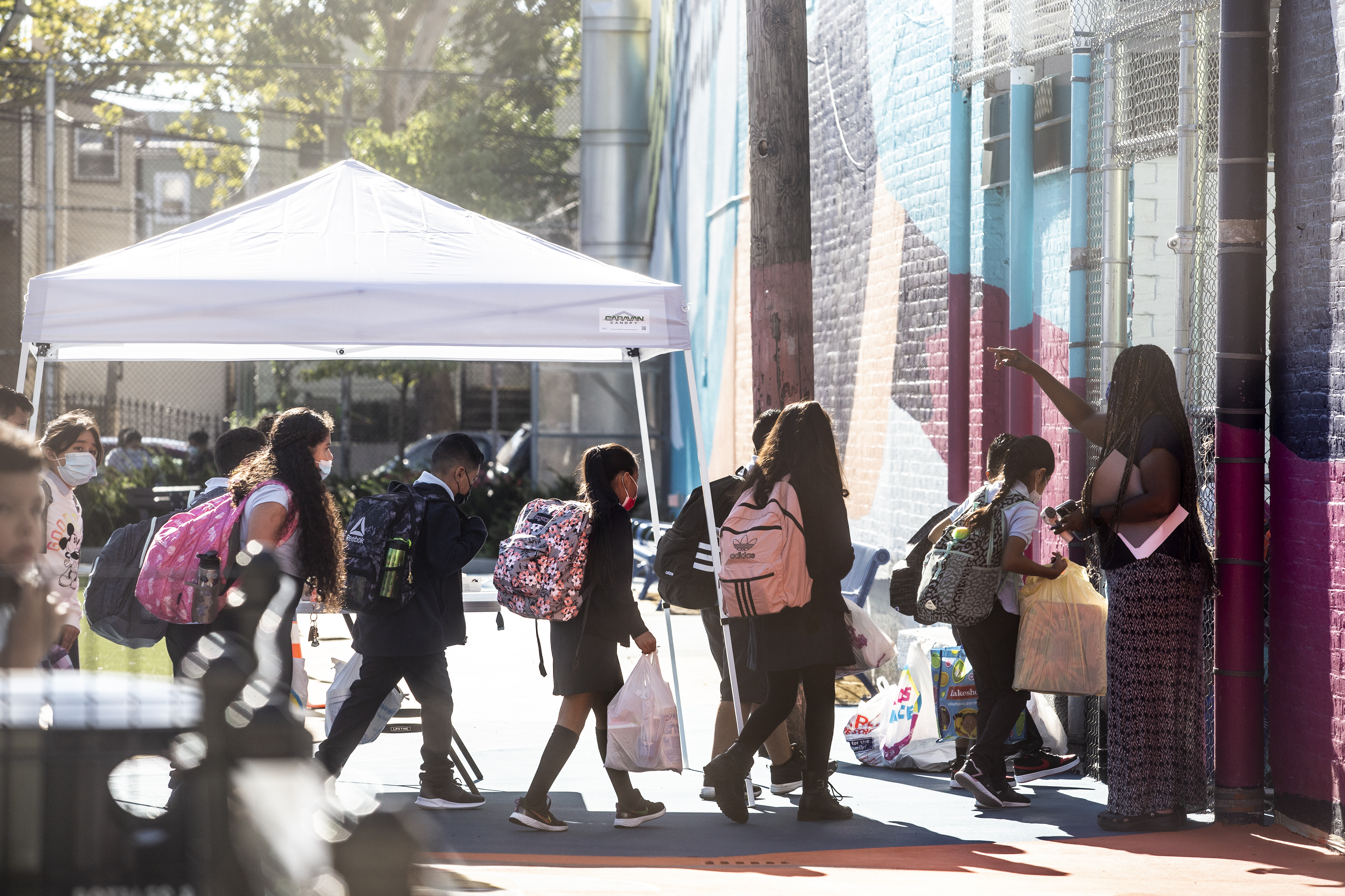 Several students make their way into Newark's Lafayette Street School on the first day of classes.