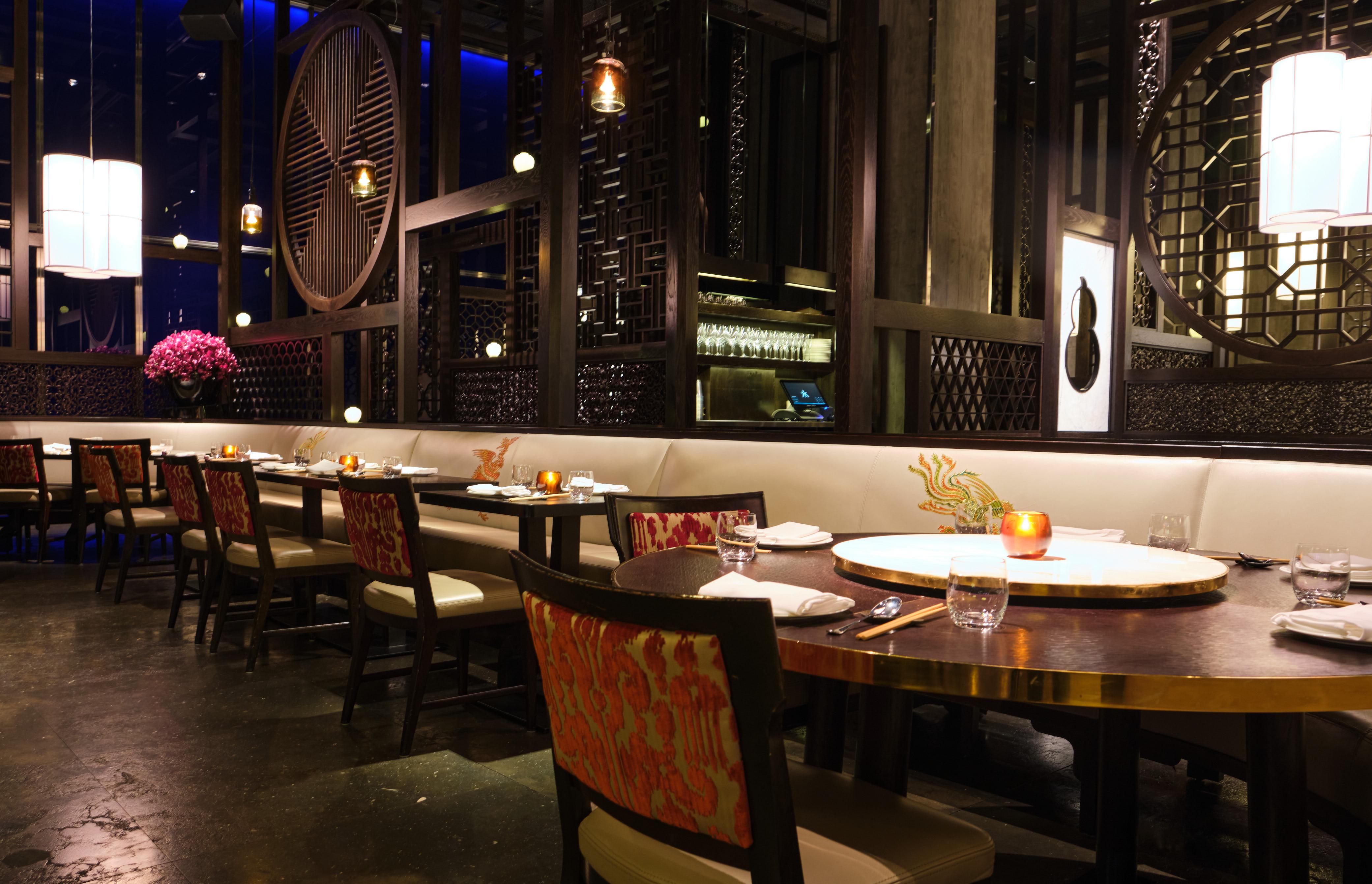 An Asian-inspired dark dining room