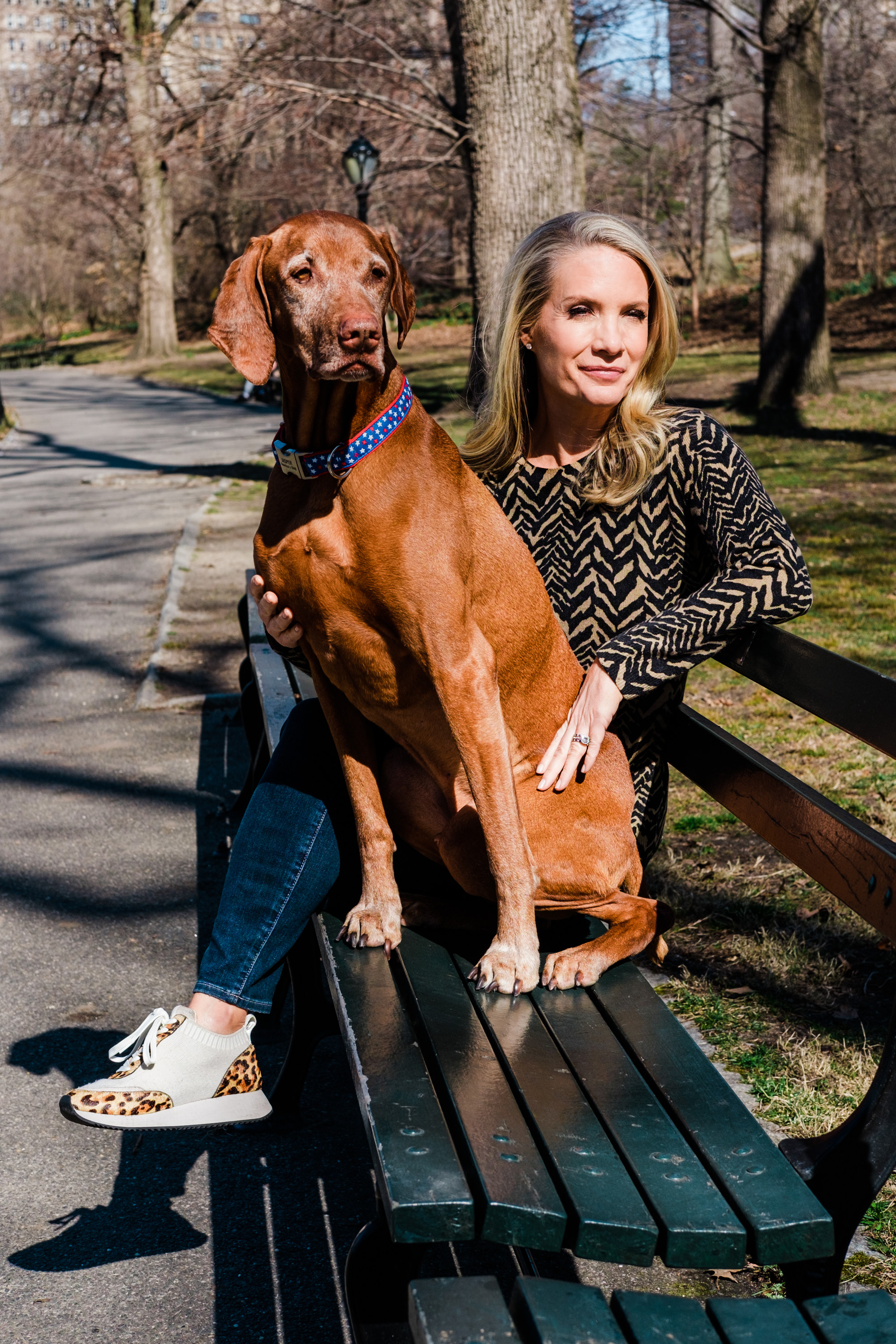 Dana Perino and her dog Jasper sit in Central Park in New York on Sunday, March 21, 2021.