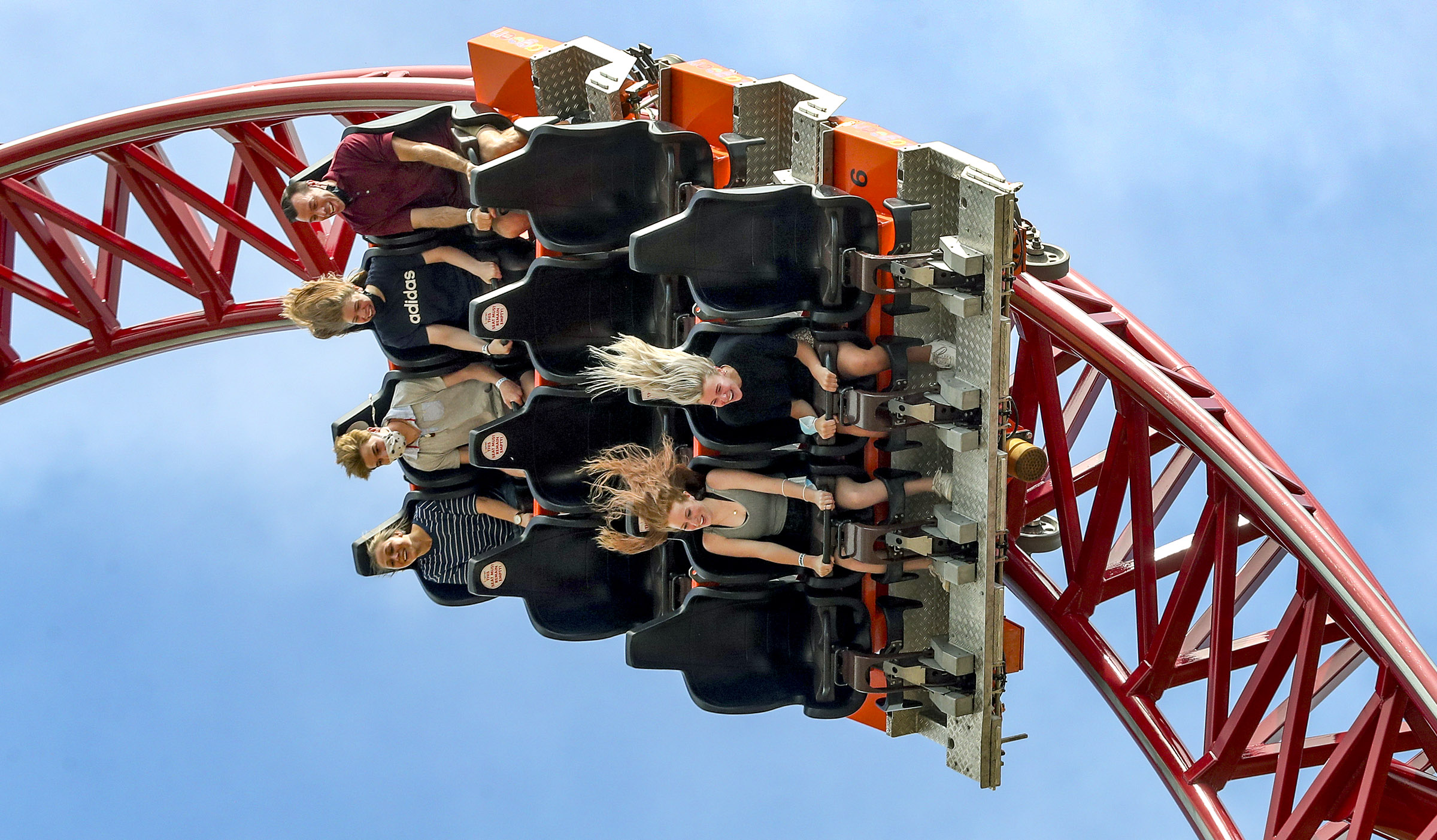 Guests scream with excitement as they ride the Cannibal at Lagoon in Farmington on Monday, June 15, 2020.
