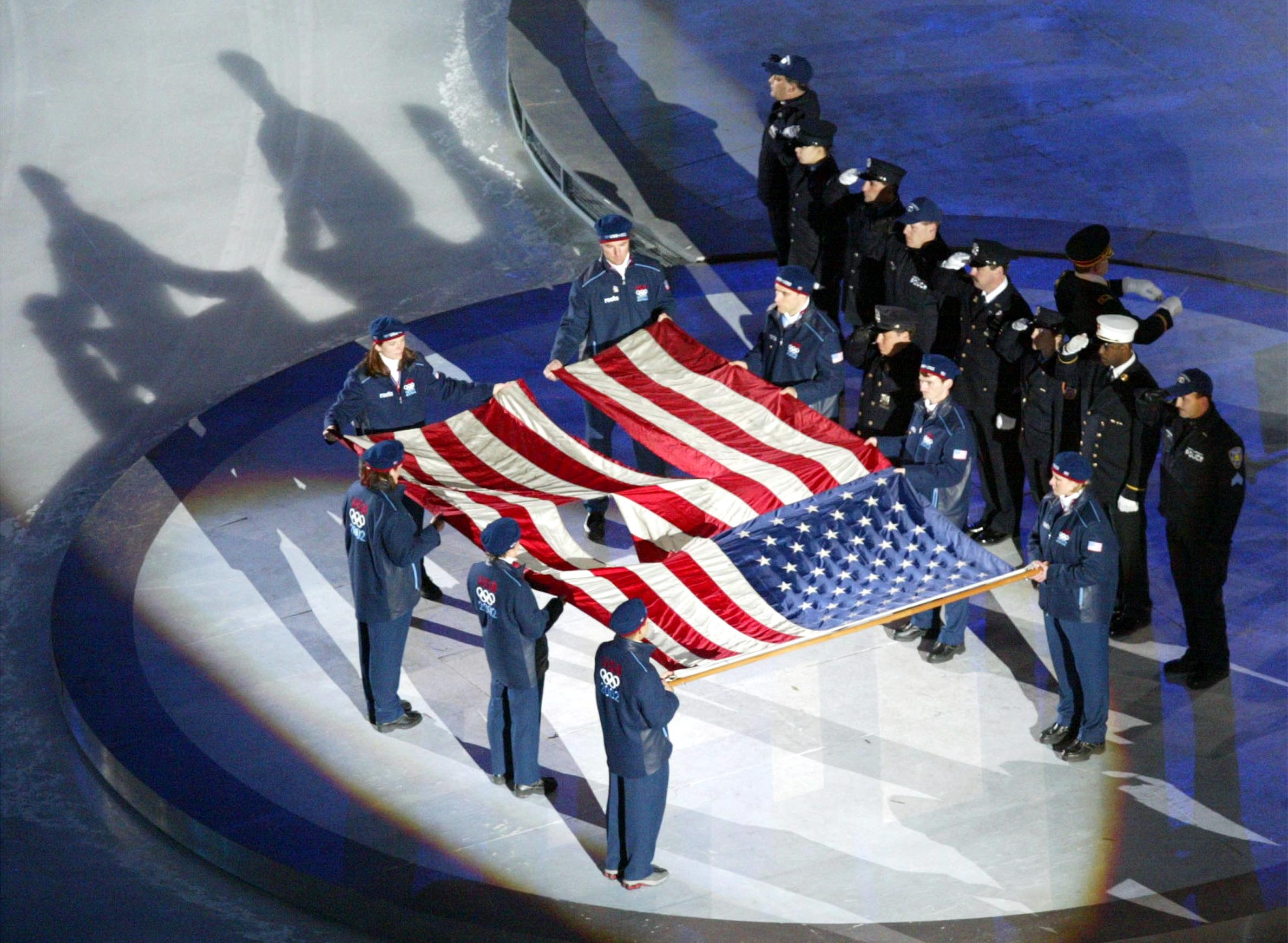 The World Trade Center flag is presented by U.S. athletes and members of the New York Police and Fire departments at the 2002 Winter Games.