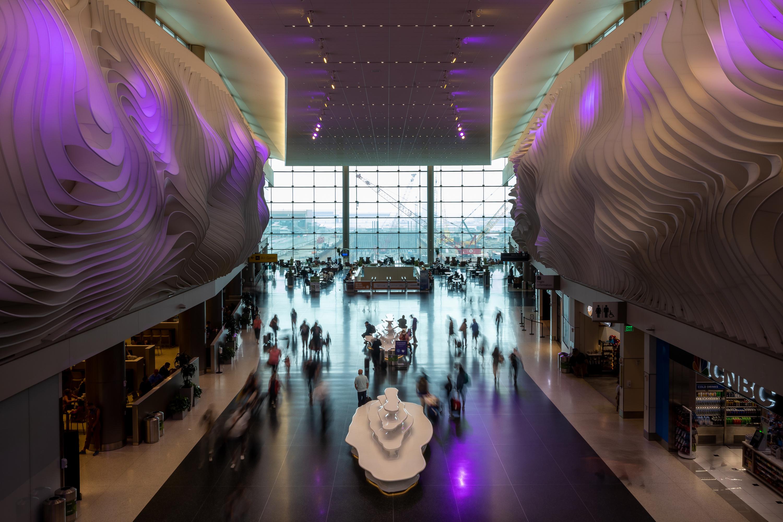 Travelers move through Salt Lake City International Airport in Salt Lake City on Wednesday, Aug. 18, 2021.