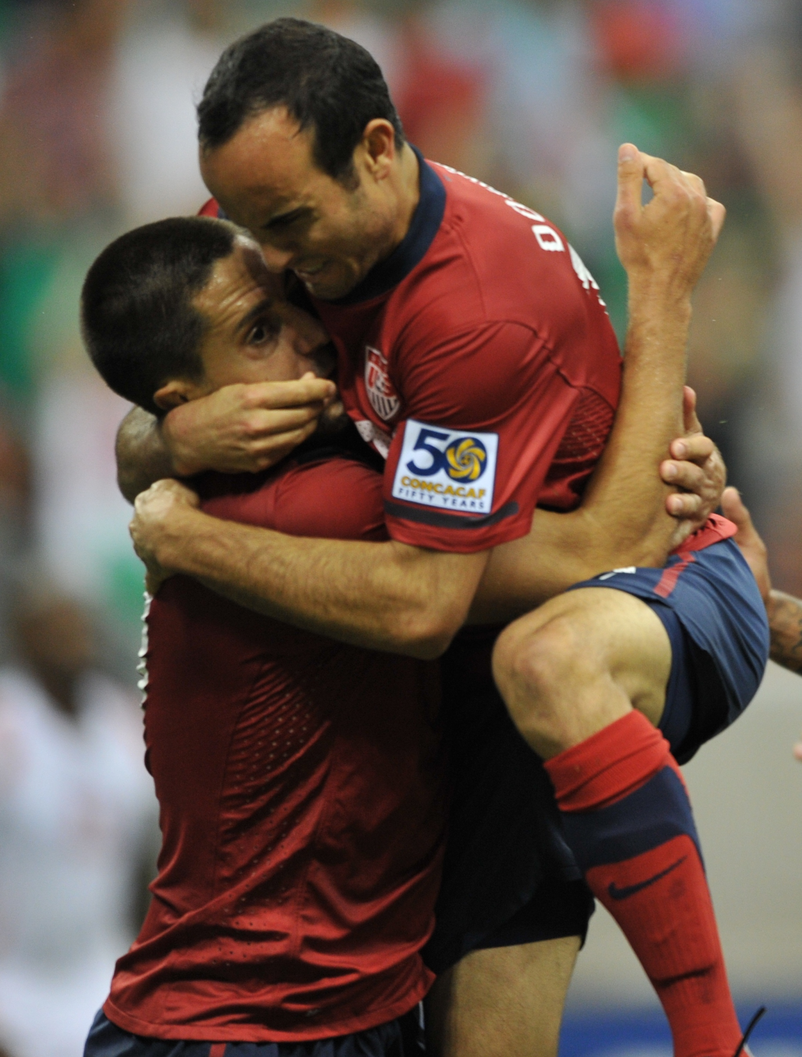 Clint Dempsey (L) of the US is hugged by