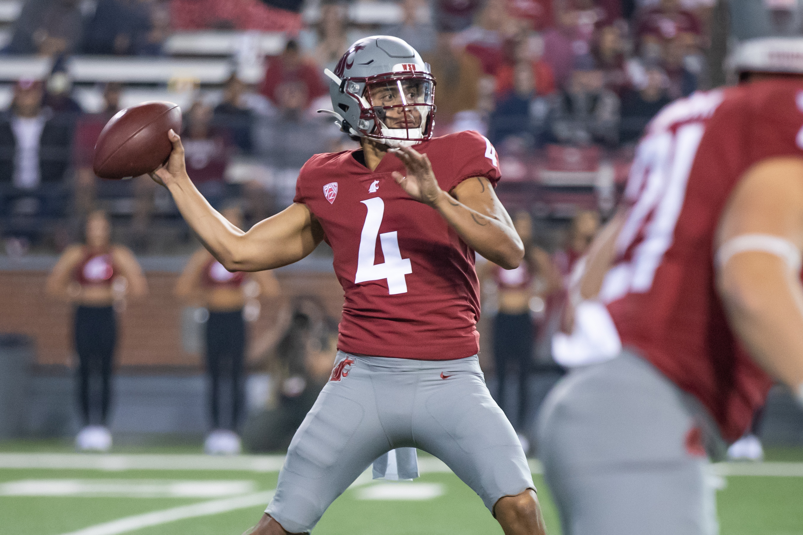 PULLMAN, WA - SEPTEMBER 4: Washington State quarterback Jayden de Laura (4) throws a pass during the first half of a non-conference matchup between the Utah State Aggies and the Washington State Cougars on September 4, 2021, at Martin Stadium in Pullman, WA.