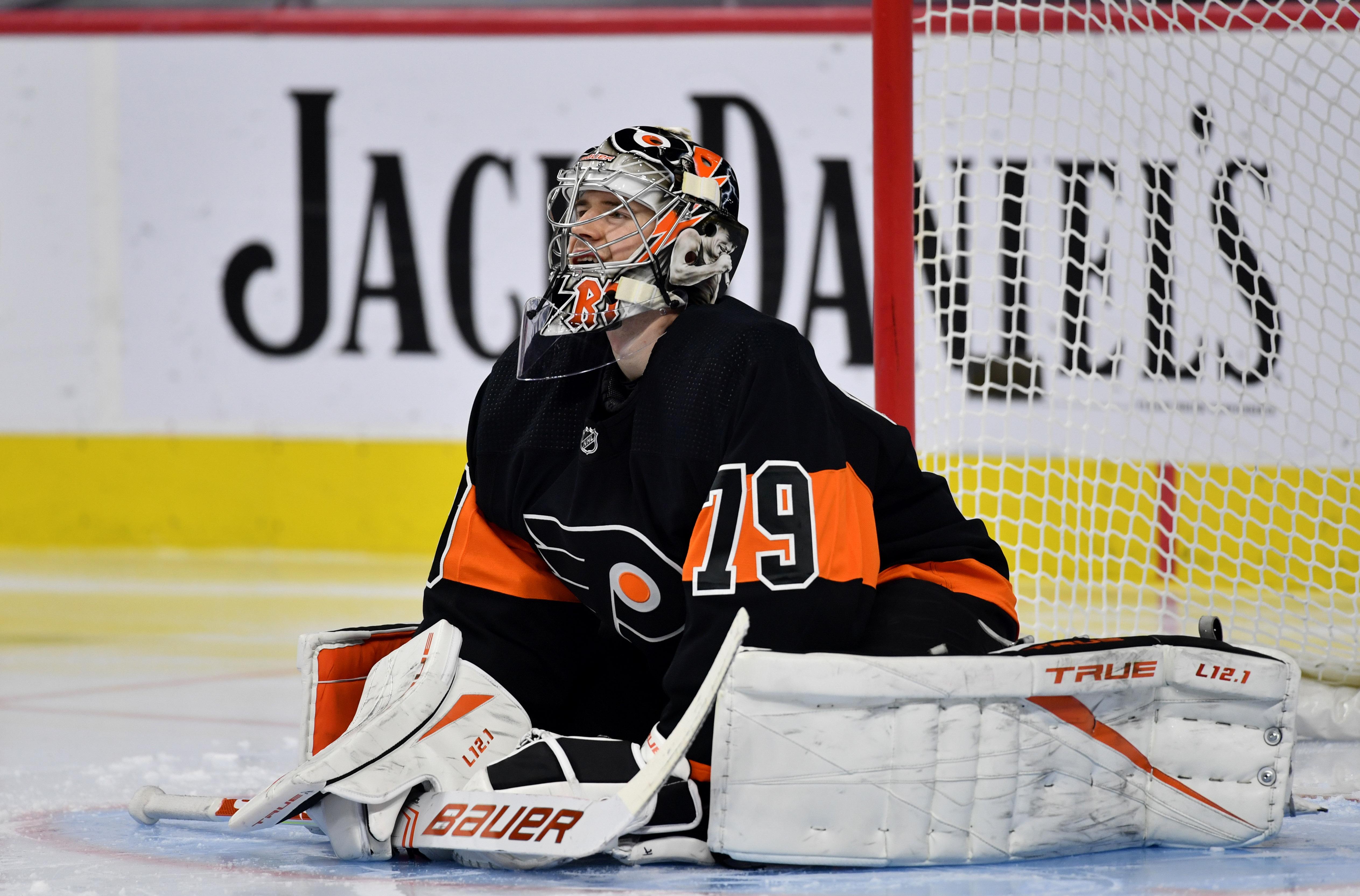 Philadelphia, Pennsylvania, USA; Philadelphia Flyers goalie Carter Hart (79) stretches in the third period against the Buffalo Sabres at Wells Fargo Center.