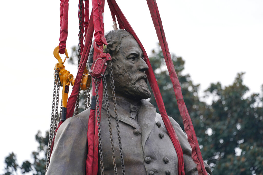 The towering statue of Confederate Gen. Robert E. Lee in Richmond, Virginia, is removed.