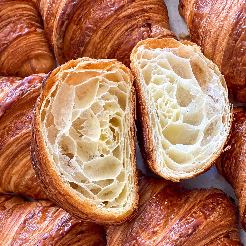 A croissant cut in half from Le Marais Bakery