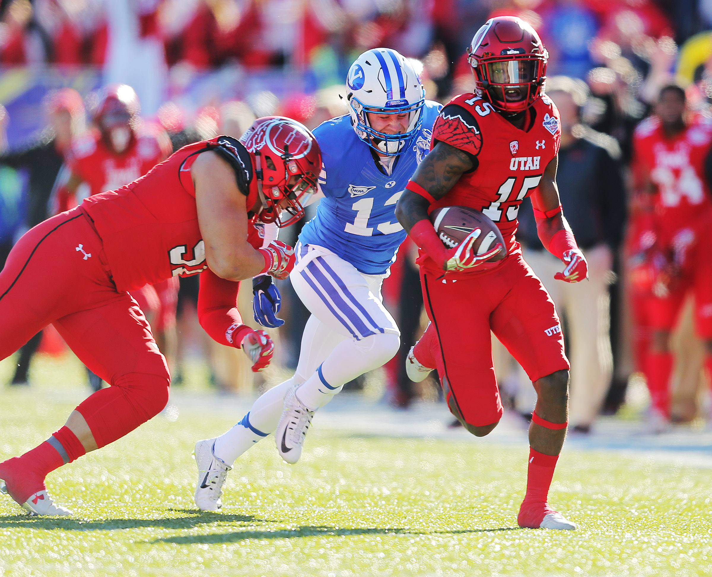 Utah defensive back Dominique Hatfield returns an interception for a TD as Utah and BYU play in Las Vegas Bowl in 2015.