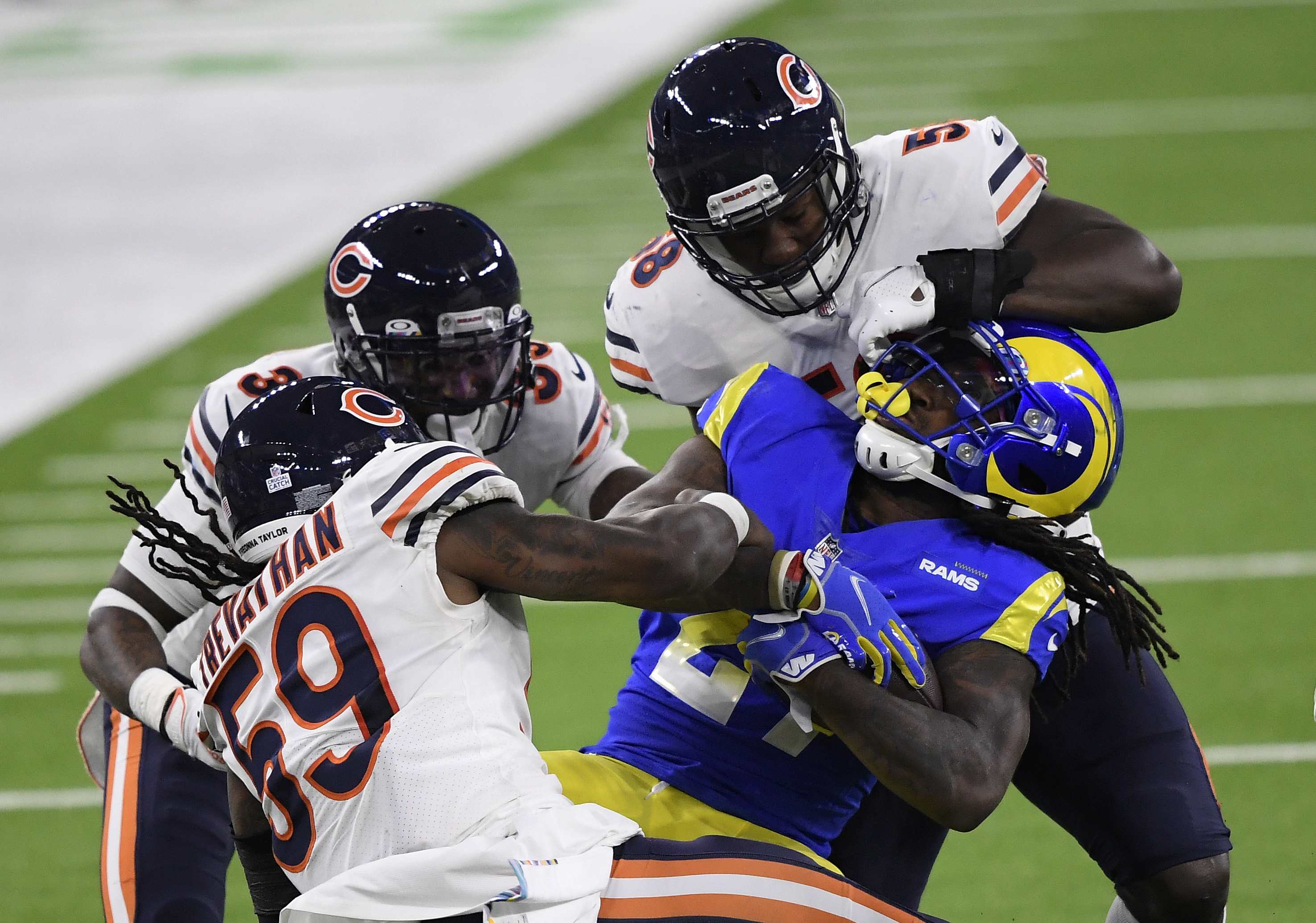 Bears linebackers Roquan Smith and Danny Trevathan tackle Rams running back Darrell Henderson last year.