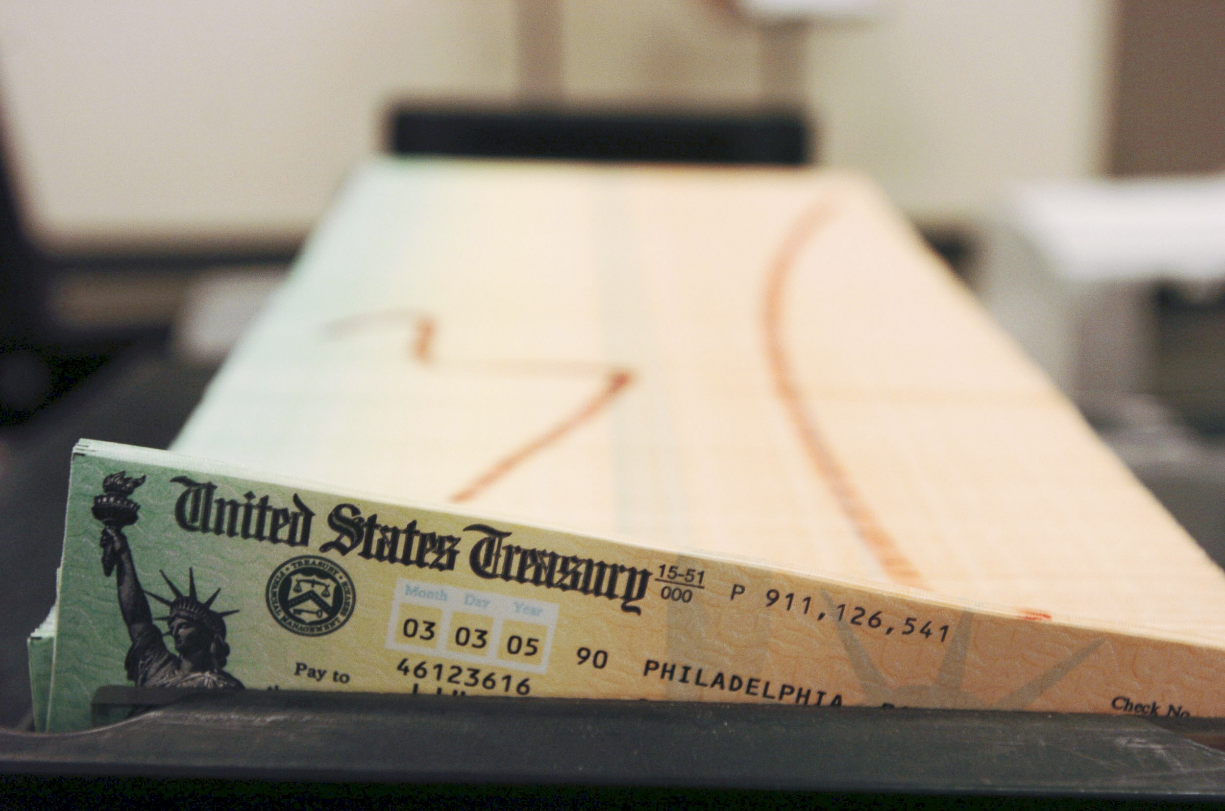 Trays of Social Security checks wait to be mailed from the U.S. Treasury.