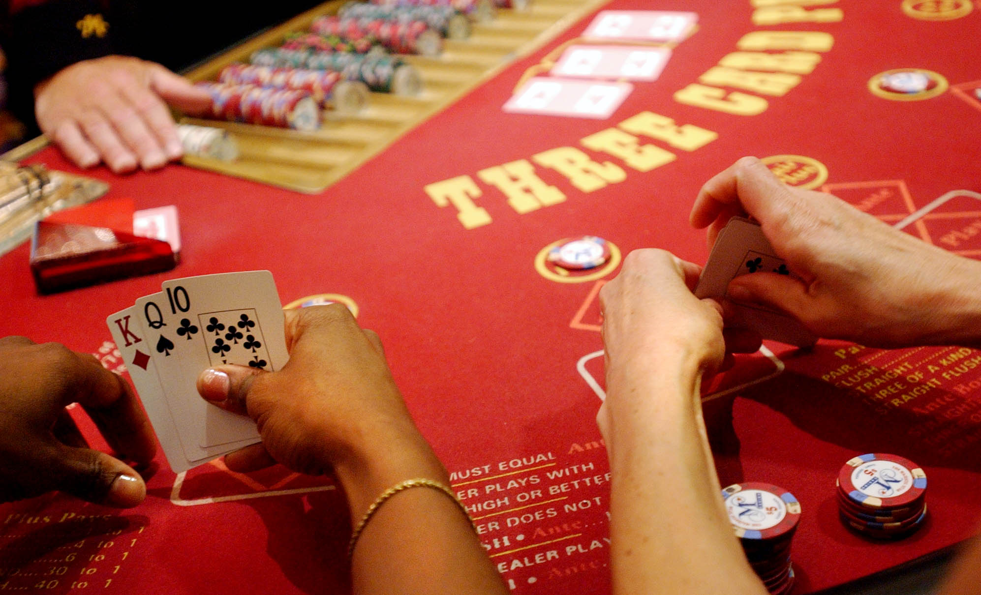Players play three card poker at the Majestic Star Casino in Gary in 2004. Casino developers will make their final pitches next month for licenses in Waukegan and Chicago's south suburbs