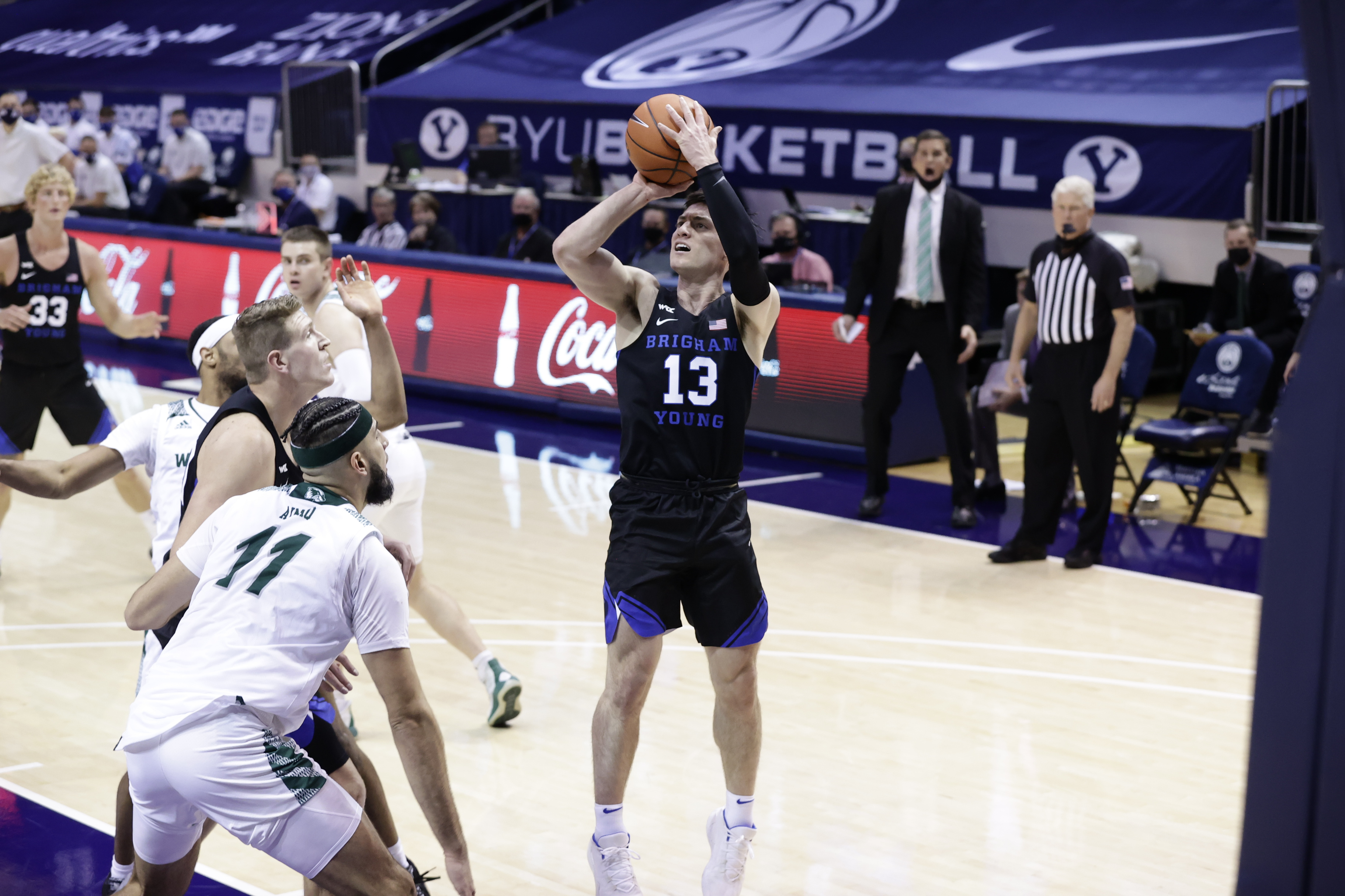 BYU's Alex Barcello (13) shoots during the Cougars' 82-60 win over the Utah Valley Wolverines.
