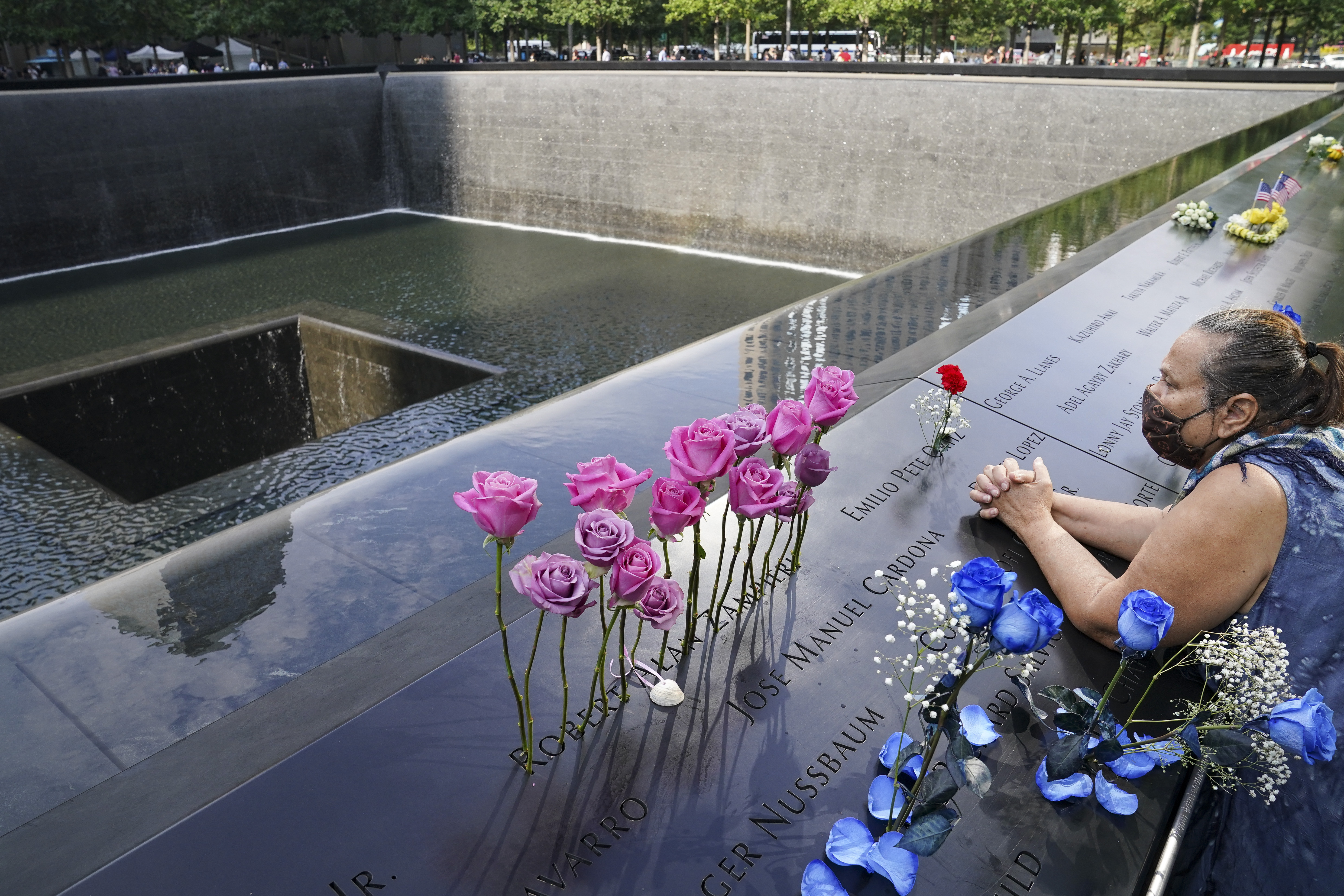 A mourner prays at the National September 11 Memorial and Museum in New York on Friday Sept. 11, 2020.