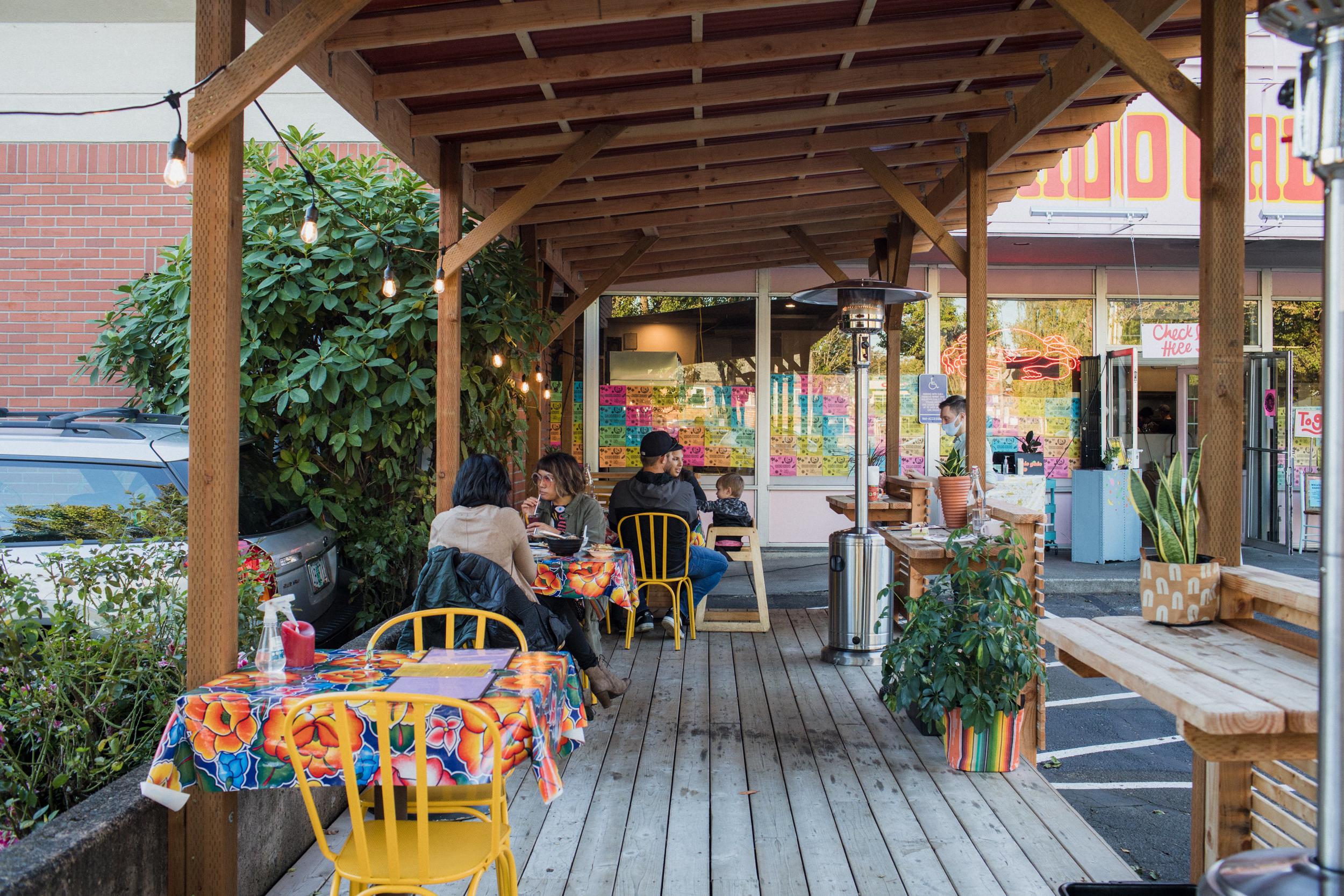 An outdoor patio at Gado Gado in Portland, Oregon