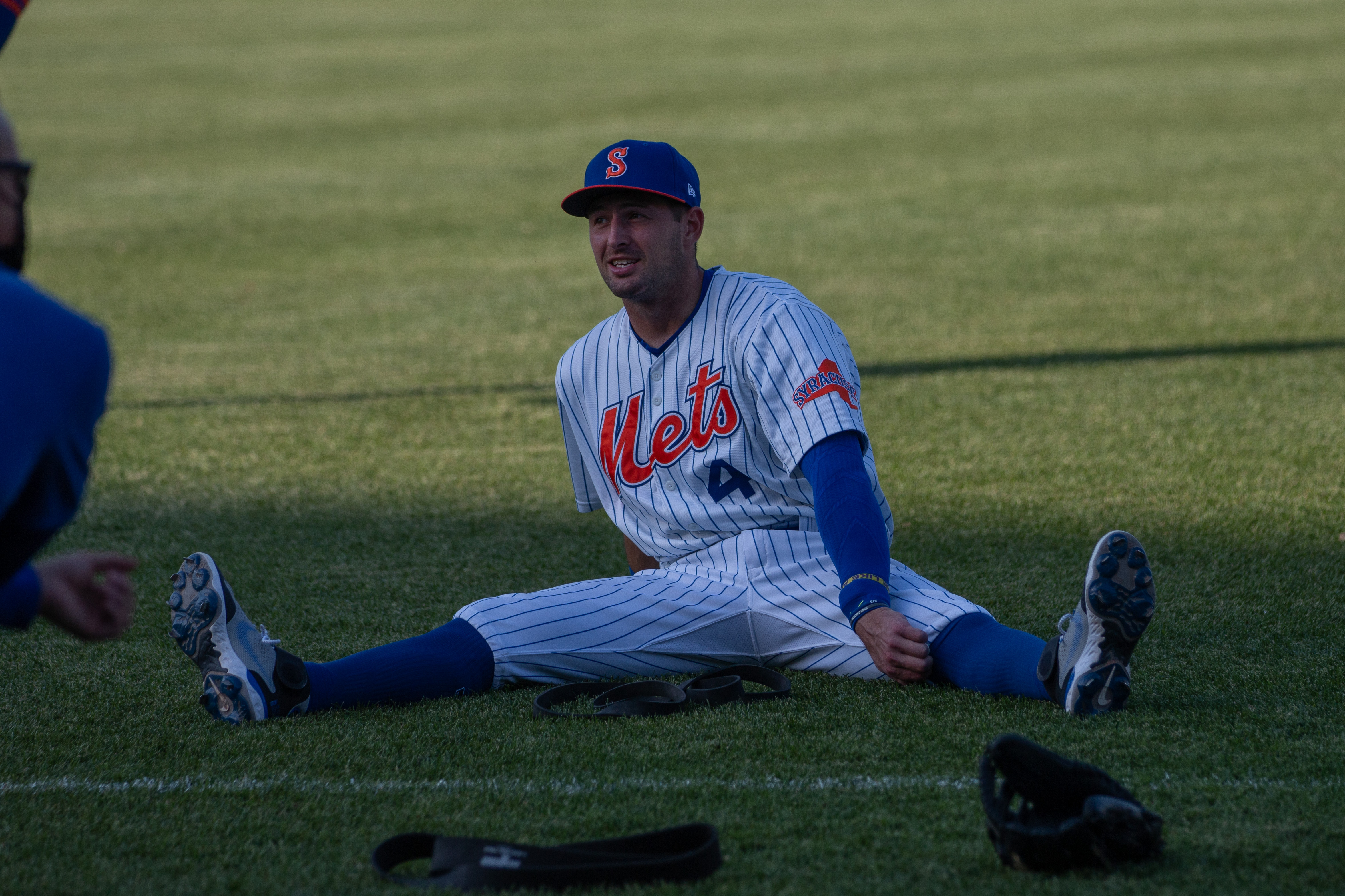 Cody Bohanek stretches before a Syracuse Mets game on May 20, 2021.
