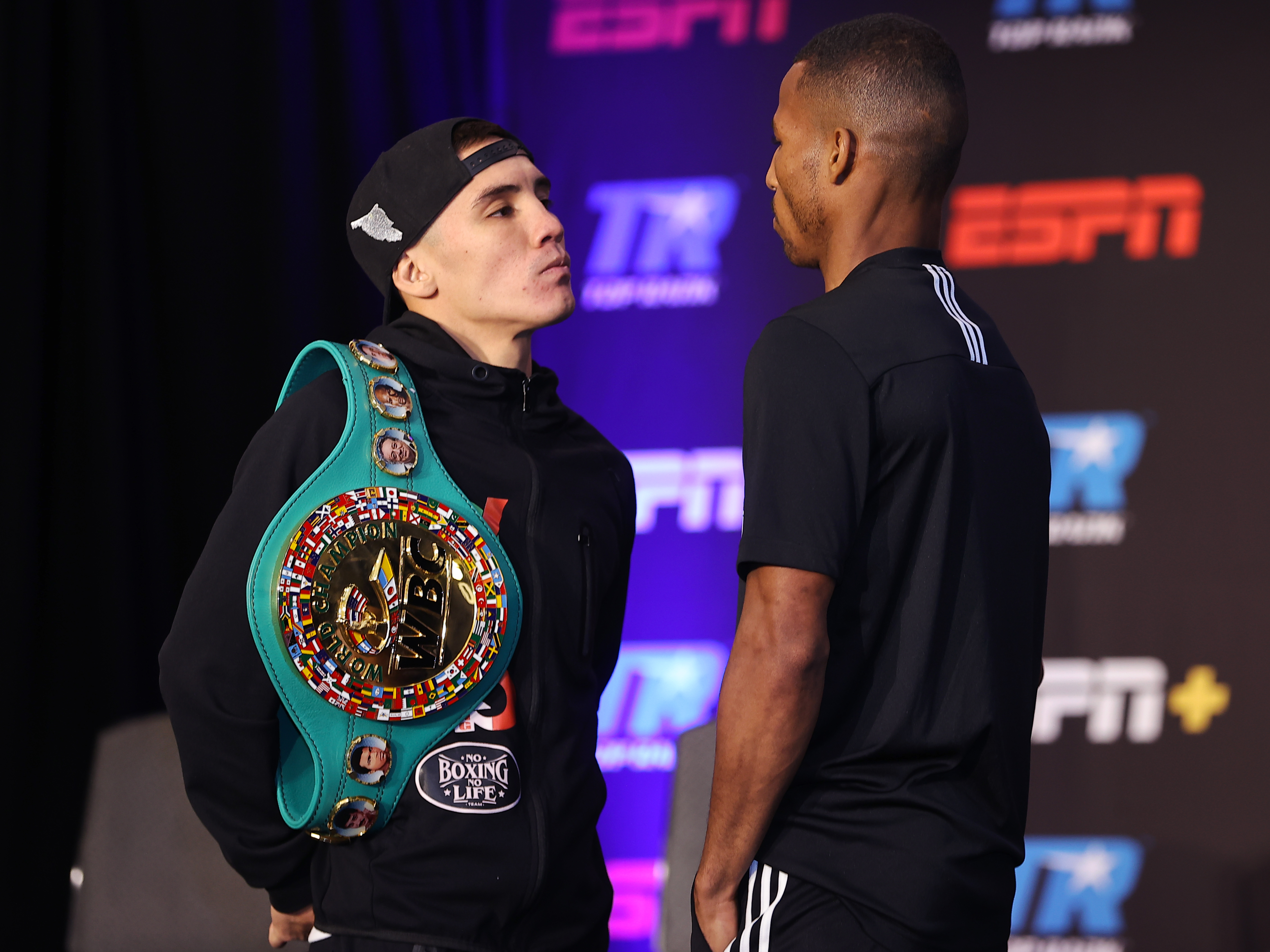 Oscar Valdez (L) and Robson Conceição (R) face-off during their press conference for the WBC super featherweight championship at Casino del Sol on September 08, 2021 in Tucson, Arizona.