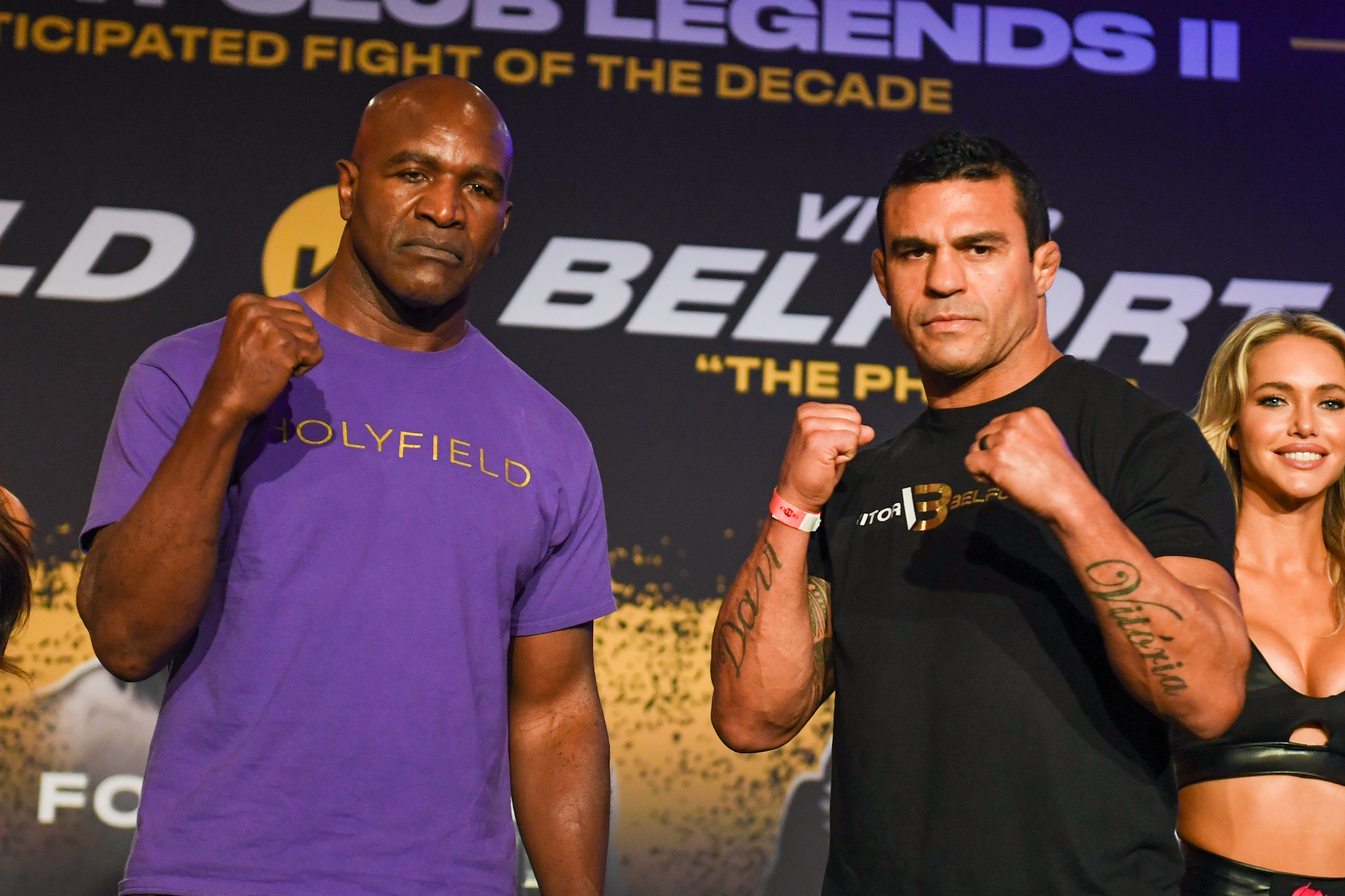 Evander Holyfield and Vitor Belfort pose for the press at a media event for their PPV boxing match.