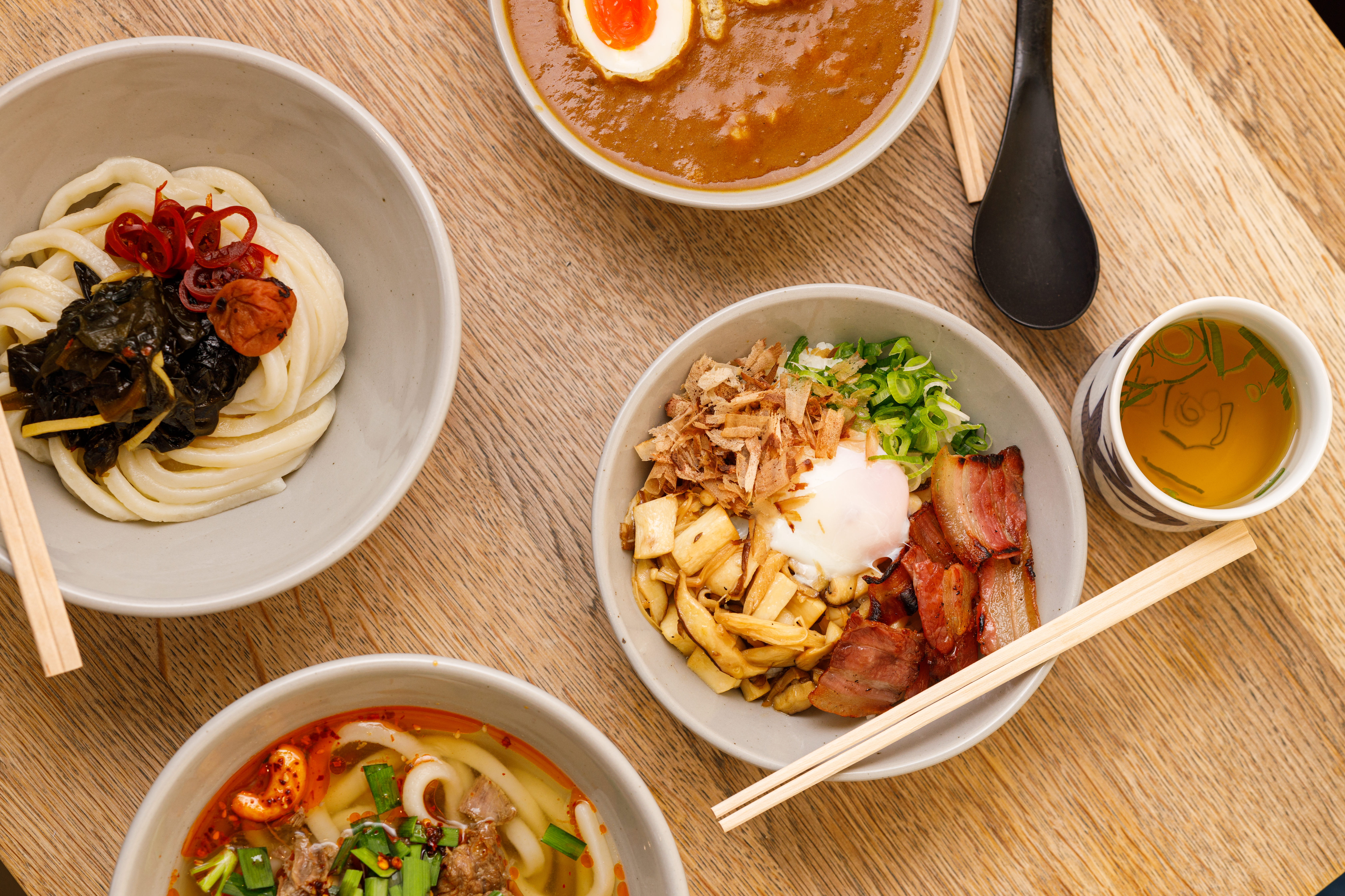 """A range of new udon dishes at Koya Ko, including curry don, triple pickle udon, and kamatama-style """"English breakfast"""" udon"""