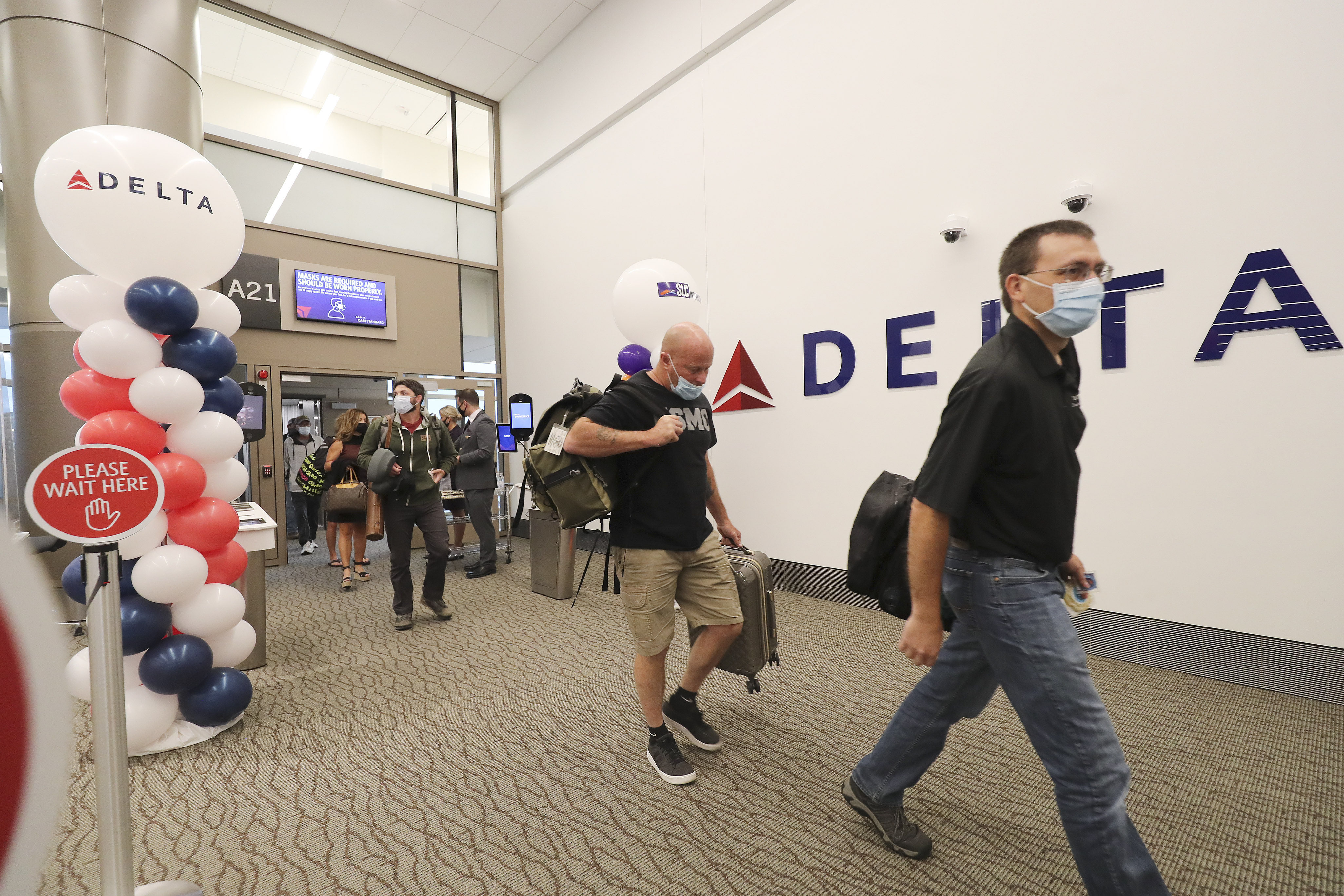 Passengers arrive from Billings, Montana, on the first flight to the new Salt Lake City International Airport in Salt Lake City.