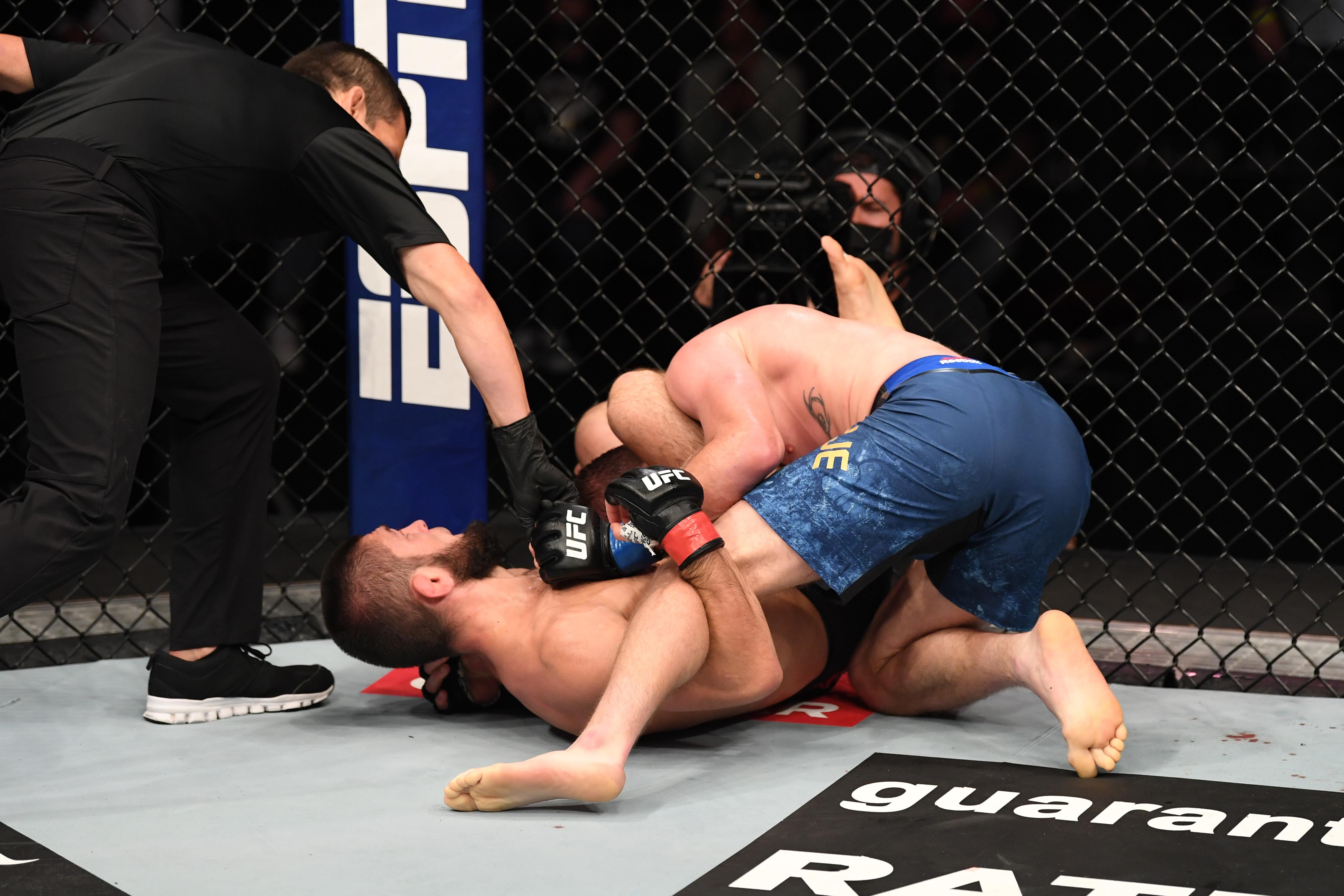 Khabib Nurmagomedov puts Justin Gaethje to sleep with a triangle choke at UFC 254.