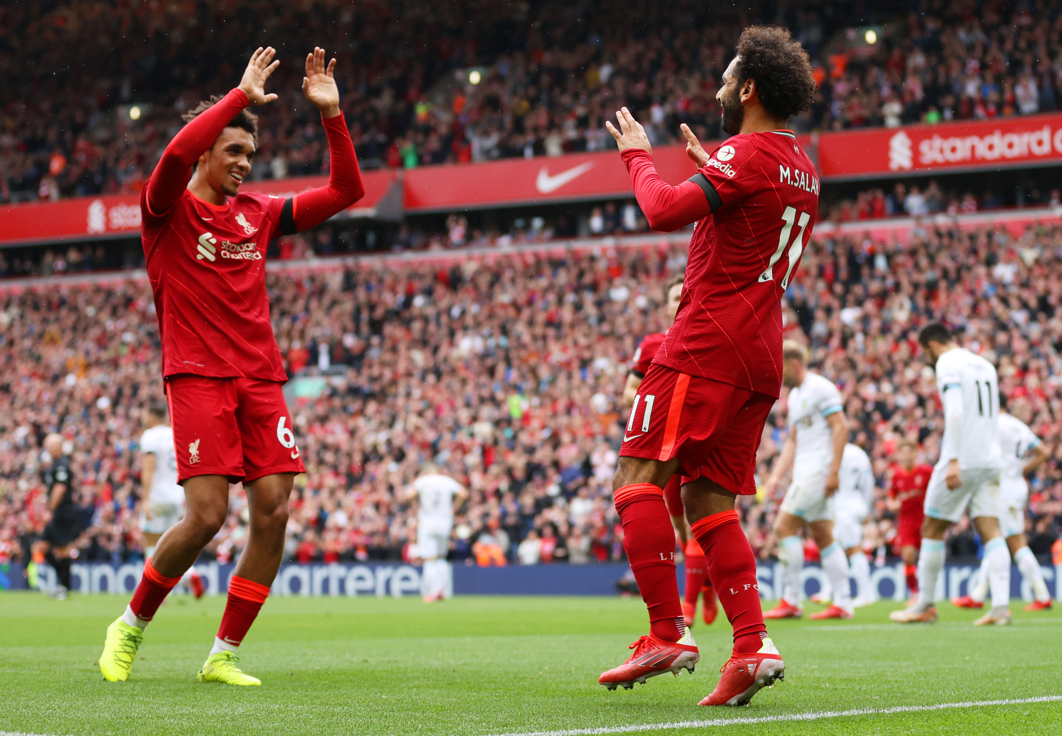 Mohamed Salah celebrates a goal with Trent Alexander-Arnold - Liverpool - Premier League