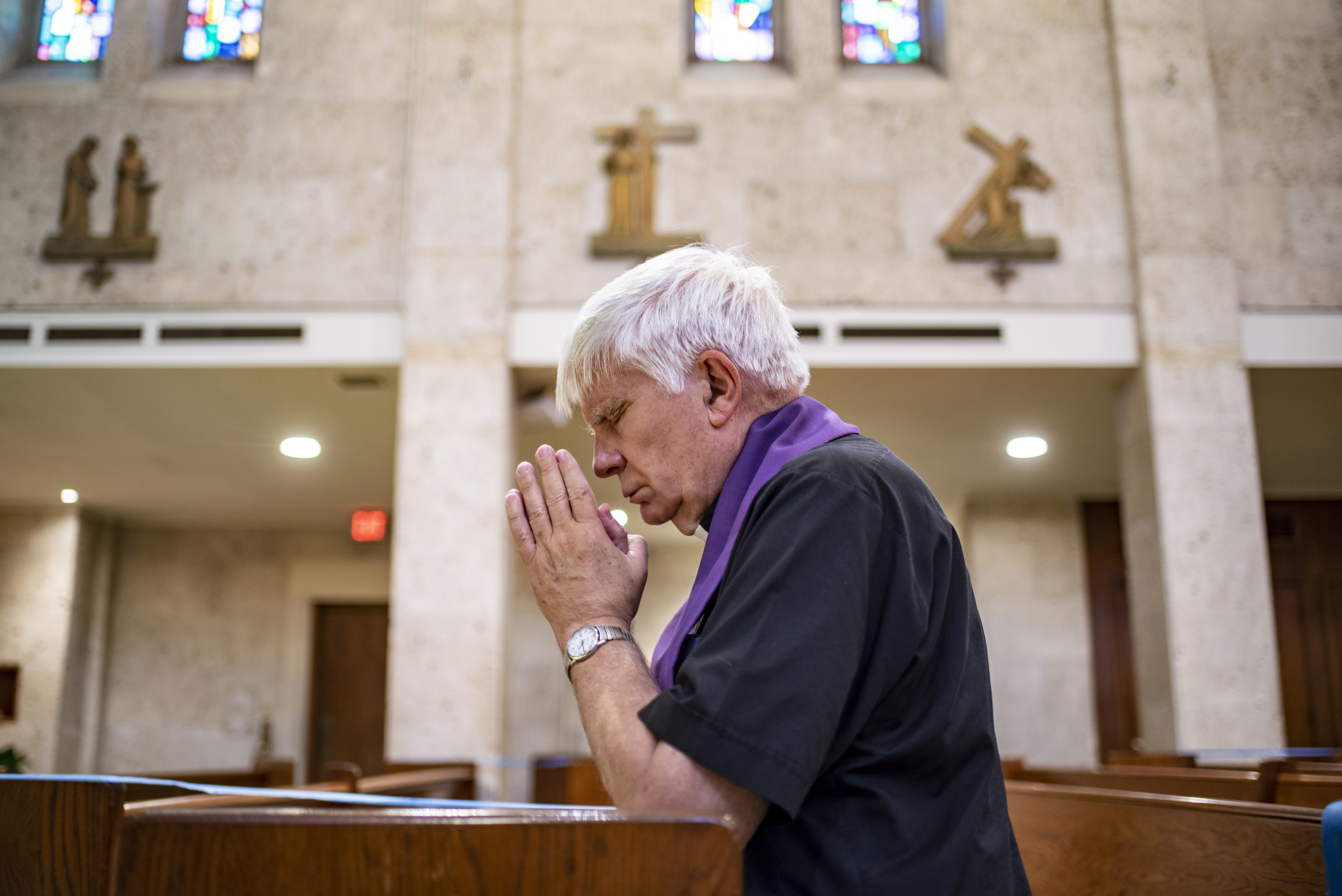 """Father Bruce Nieli prays at St. Austin Catholic Parish in Austin, Texas, on Thursday, Sept. 9, 2021. Father Nieli was at New York's ground zero shortly after the Sept. 11 attacks when officials made the largest discovery of bodies since the attack. Through his experience, Father Nieli came to better develop a """"spirit of reconciliation and peace."""""""