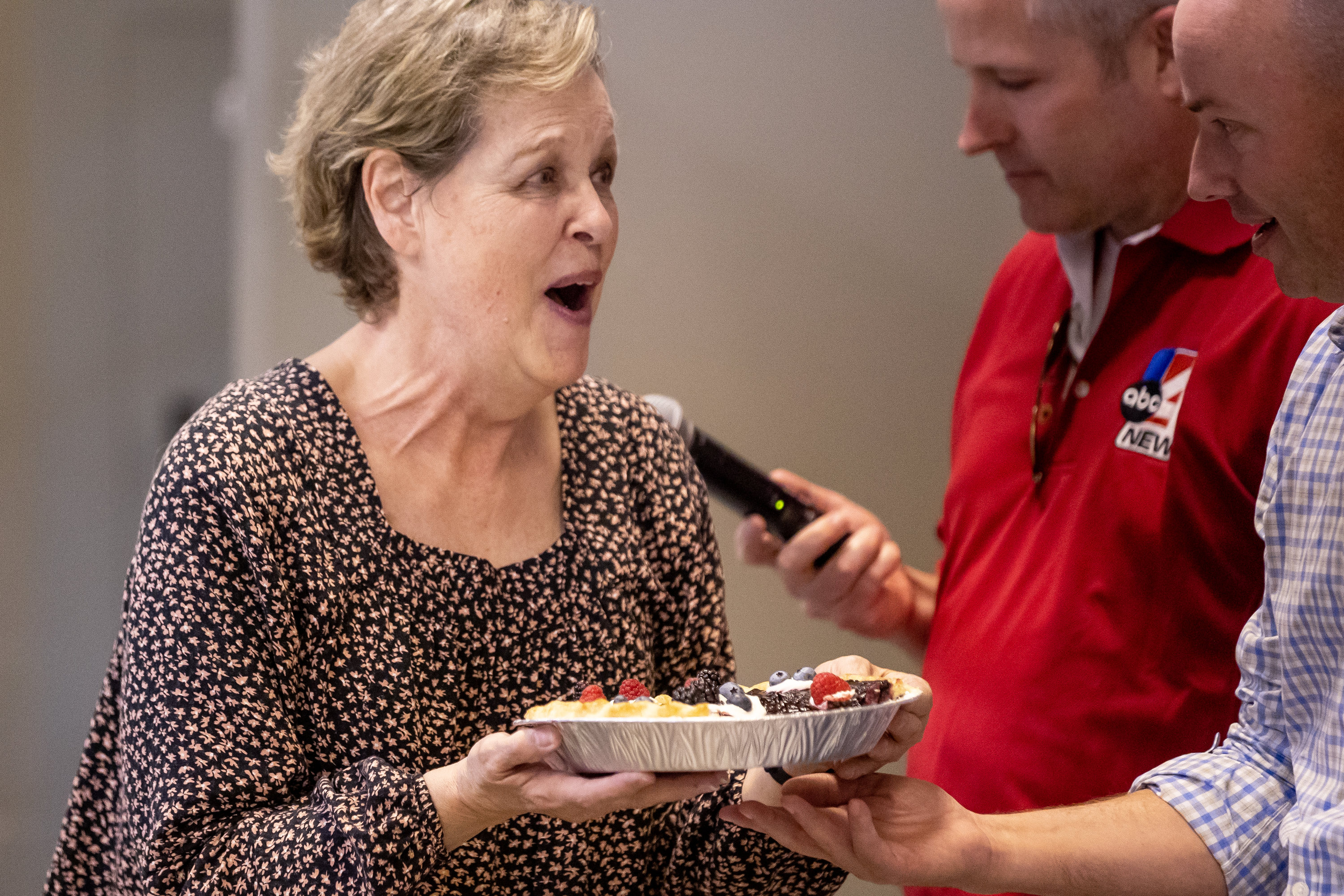 Carol Bartholomew reacts after her pie was selected as first-place winner by Gov. Spencer Cox at the Utah State Fair.