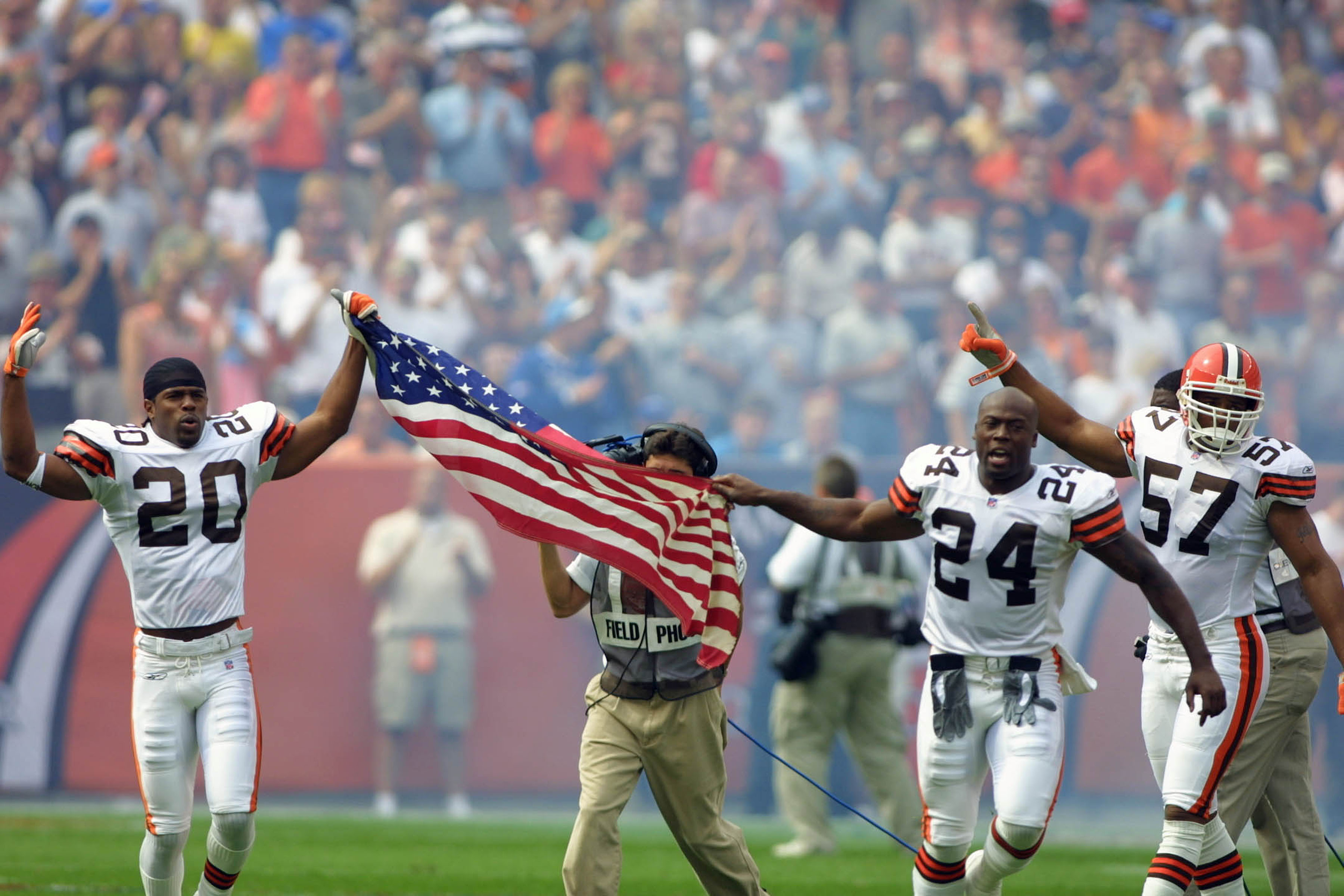 Earl Little and Corey Fuller, of the Cleveland Browns, with an American flag during pre-game ceremonies on Sept. 23, 2001.