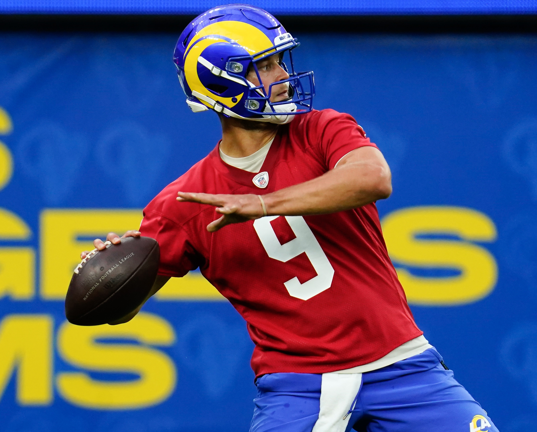 Los Angeles Rams quarterback Matthew Stafford throws a pass during an offseason workout at SoFi Stadium.