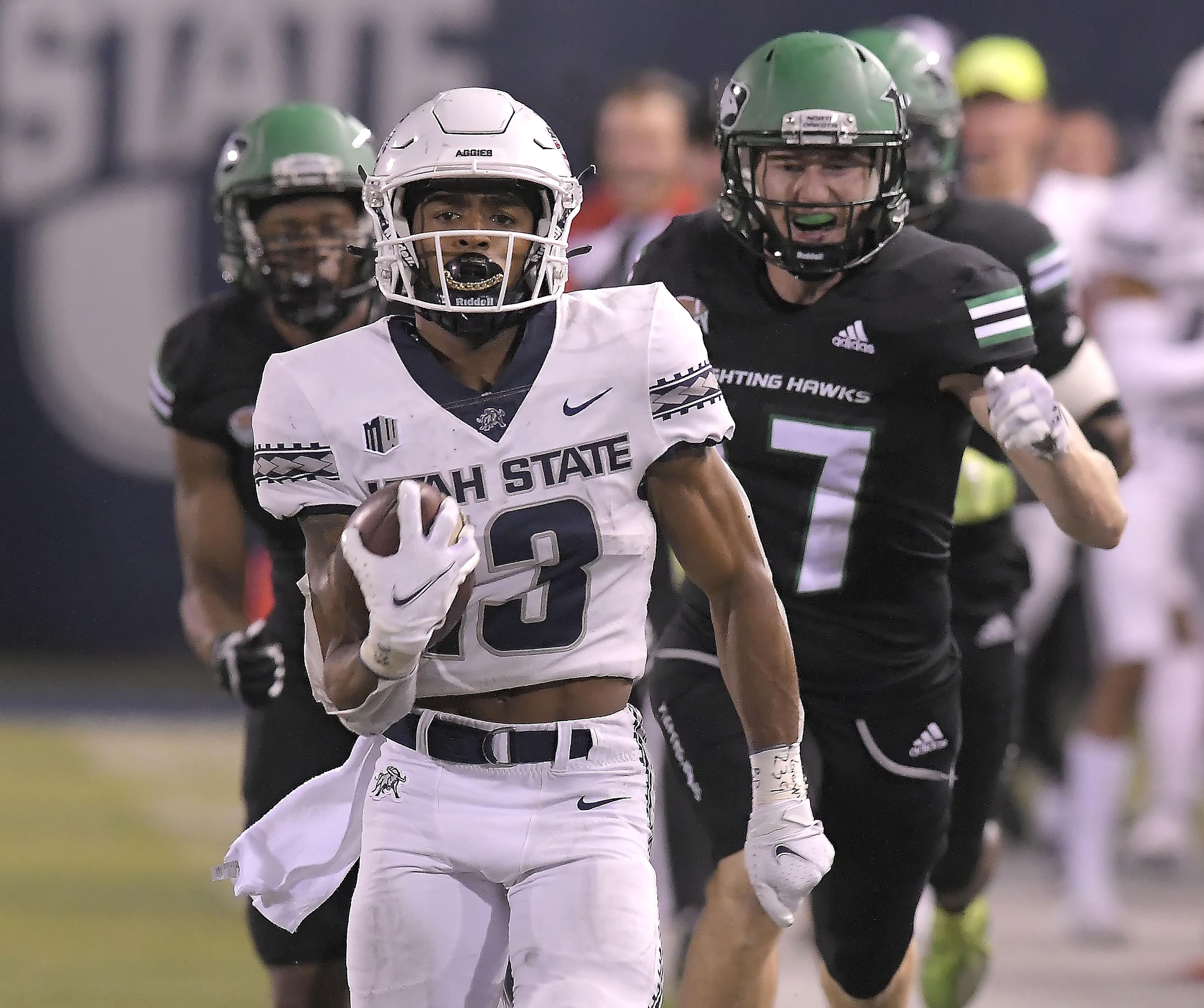 Utah State wide receiver Deven Thompkins runs down the field for a 75-yard touchdown.