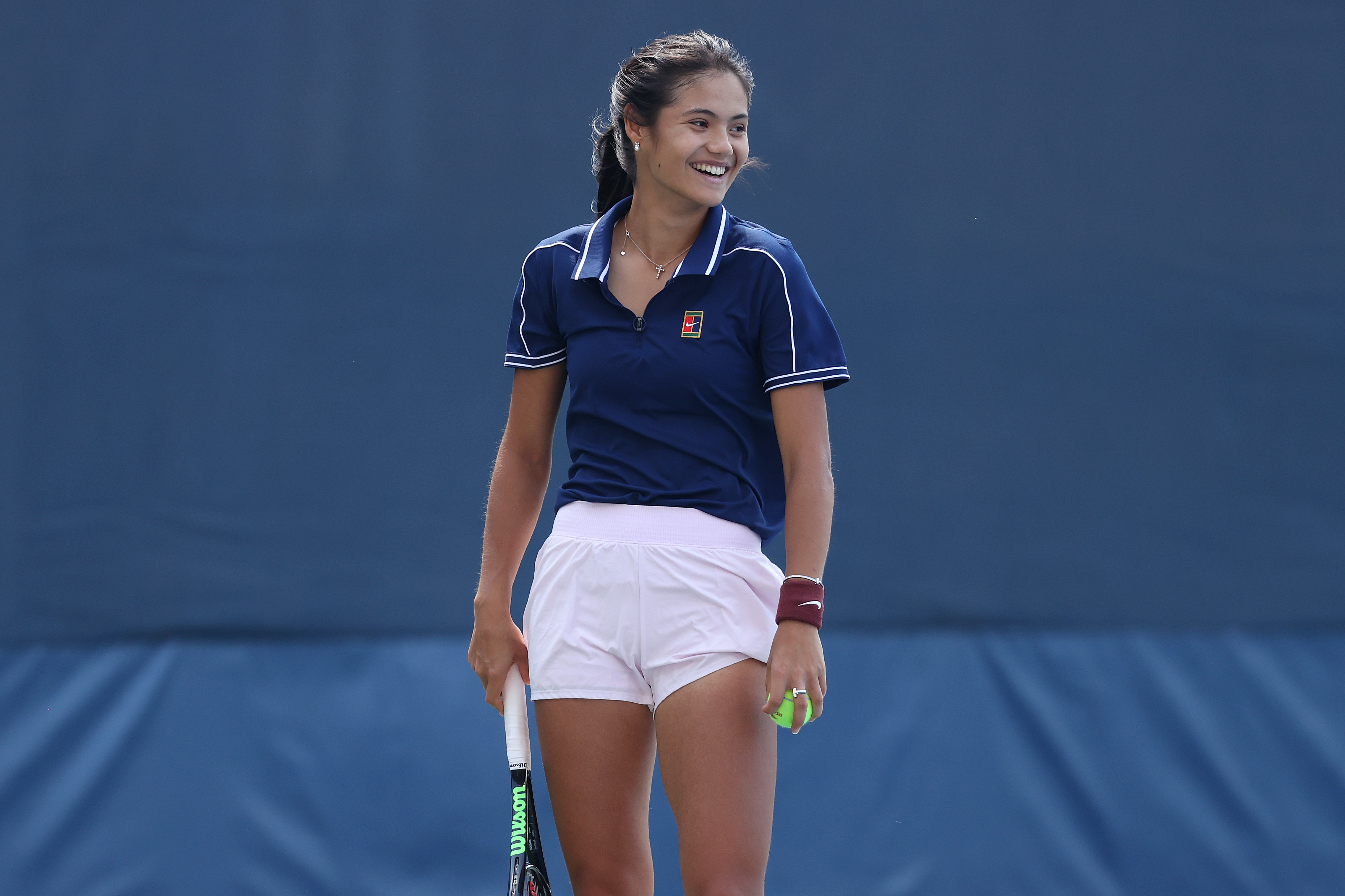 Emma Raducanu of Great Britain smiles during a training session on Day Twelve of the 2021 US Open at the USTA Billie Jean King National Tennis Center on September 10, 2021 in the Flushing neighborhood of the Queens borough of New York City.