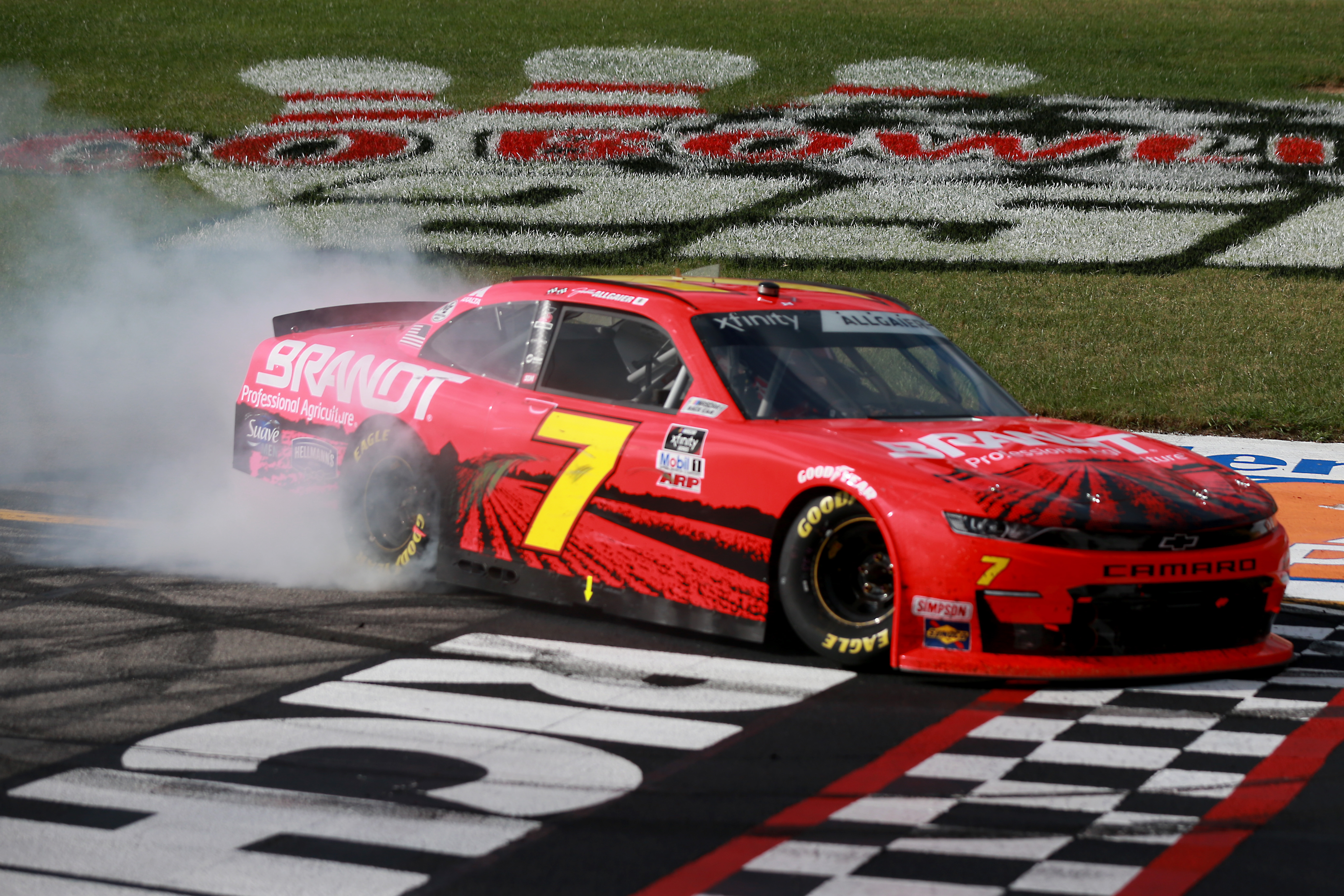 Justin Allgaier, driver of the #7 BRANDT Chevrolet, celebrates with a burnout after winning the NASCAR Xfinity Series Virginia is for Racing Lovers 250 at Richmond Raceway on September 12, 2020 in Richmond, Virginia.