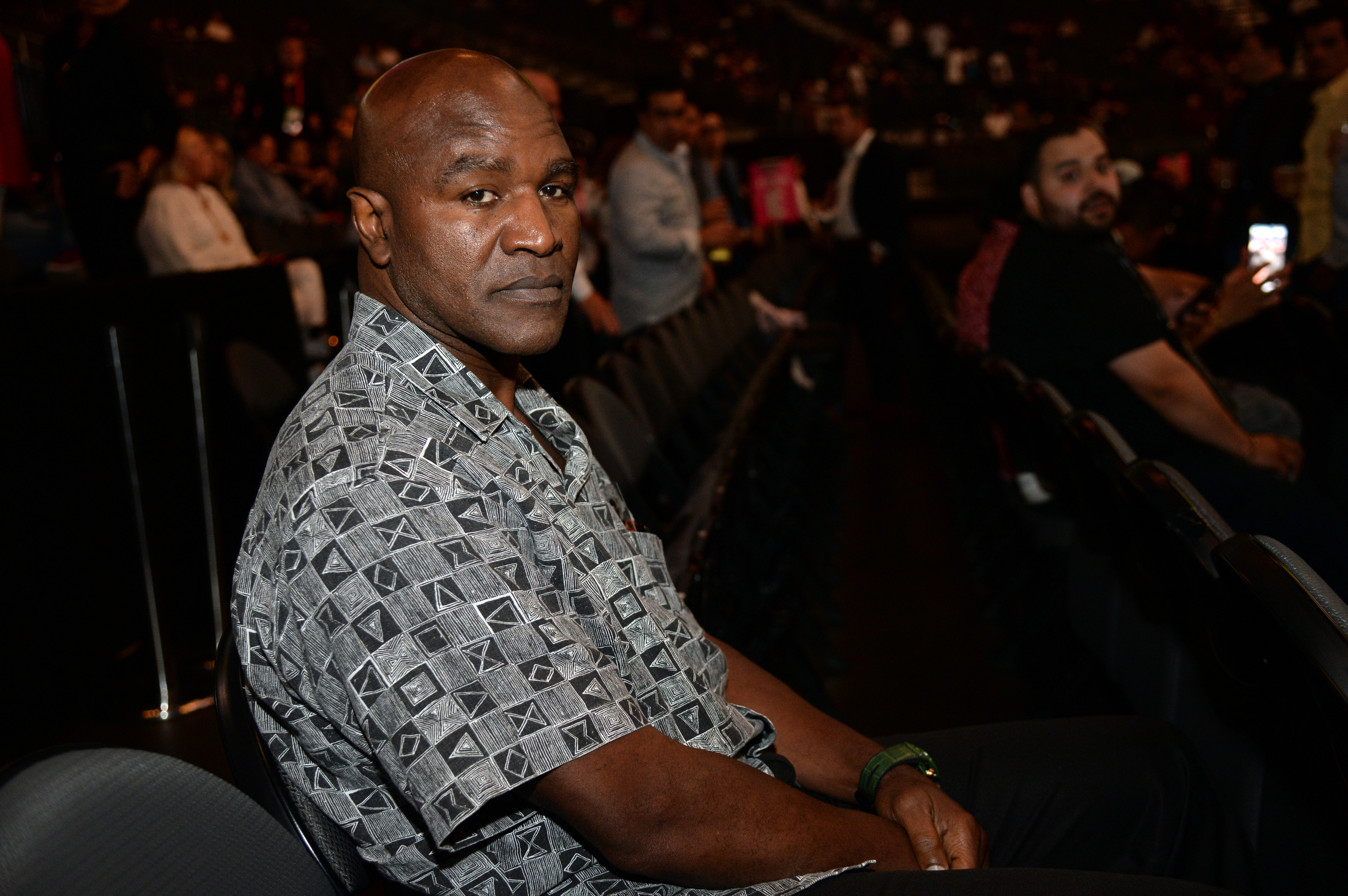 Former boxing champion Evander Holyfield attends the Canelo Alvarez (not pictured) and Daniel Jacobs (not pictured) WBC/WBA/IBF middleweight unification world championship boxing bout at T-Mobile Arena. Alvarez won via unanimous decision