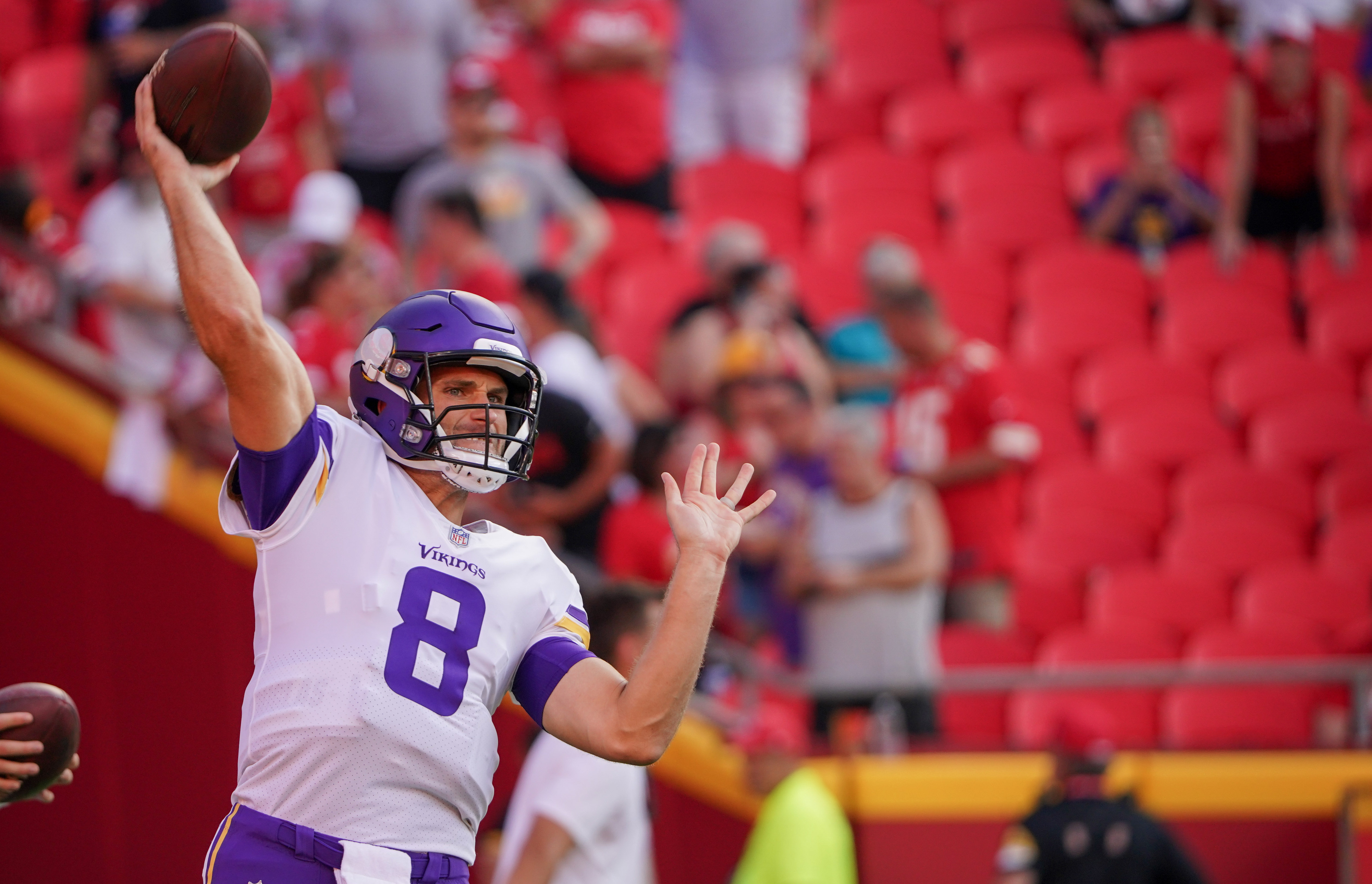 Minnesota Vikings quarterback Kirk Cousins (8) warms up against the Kansas City Chiefs before the game at GEHA Field at Arrowhead Stadium.
