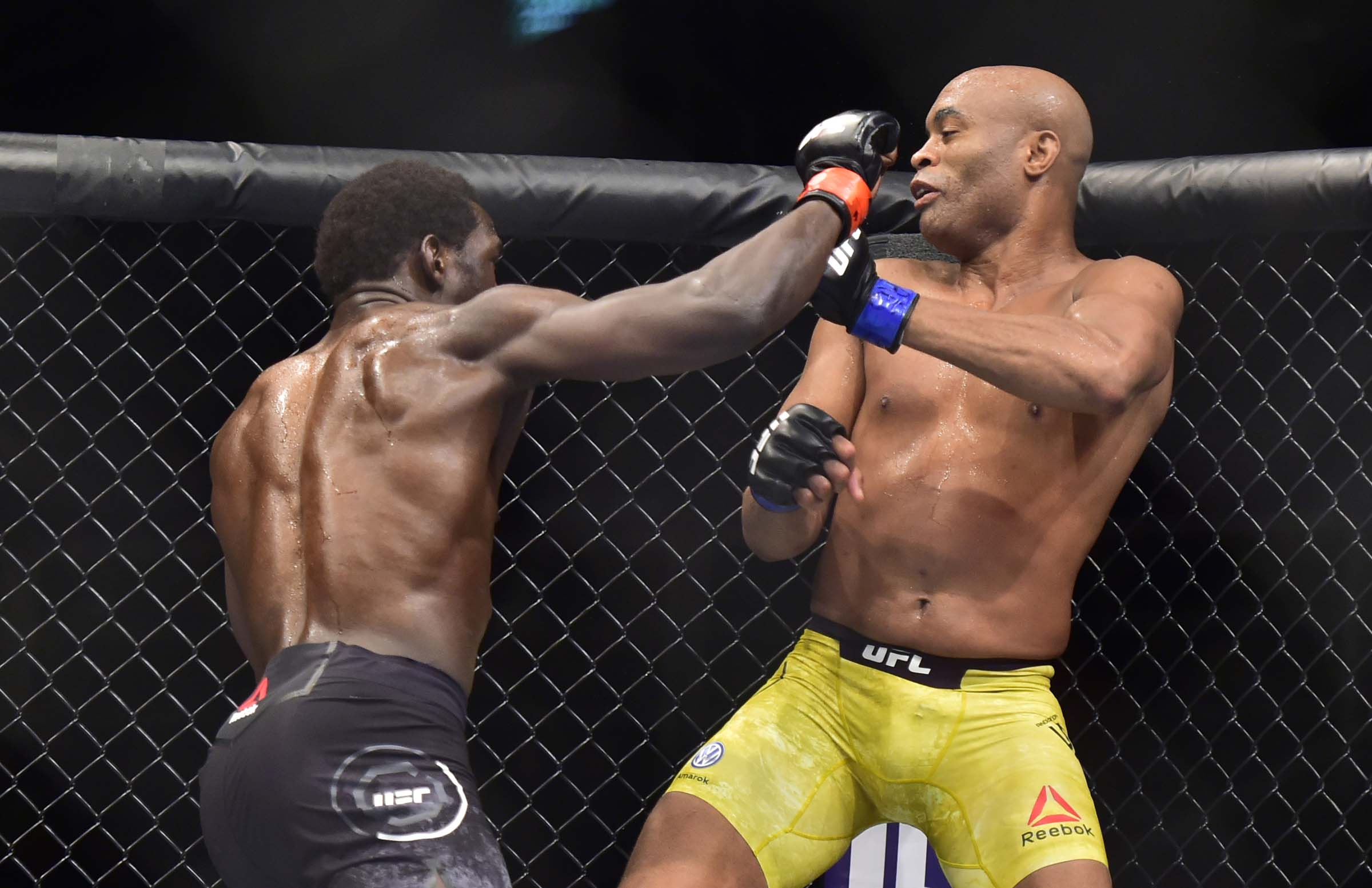 Jared Cannonier (red gloves) fights Anderson Silva (blue gloves) during UFC 237 at Jeunesse Arena