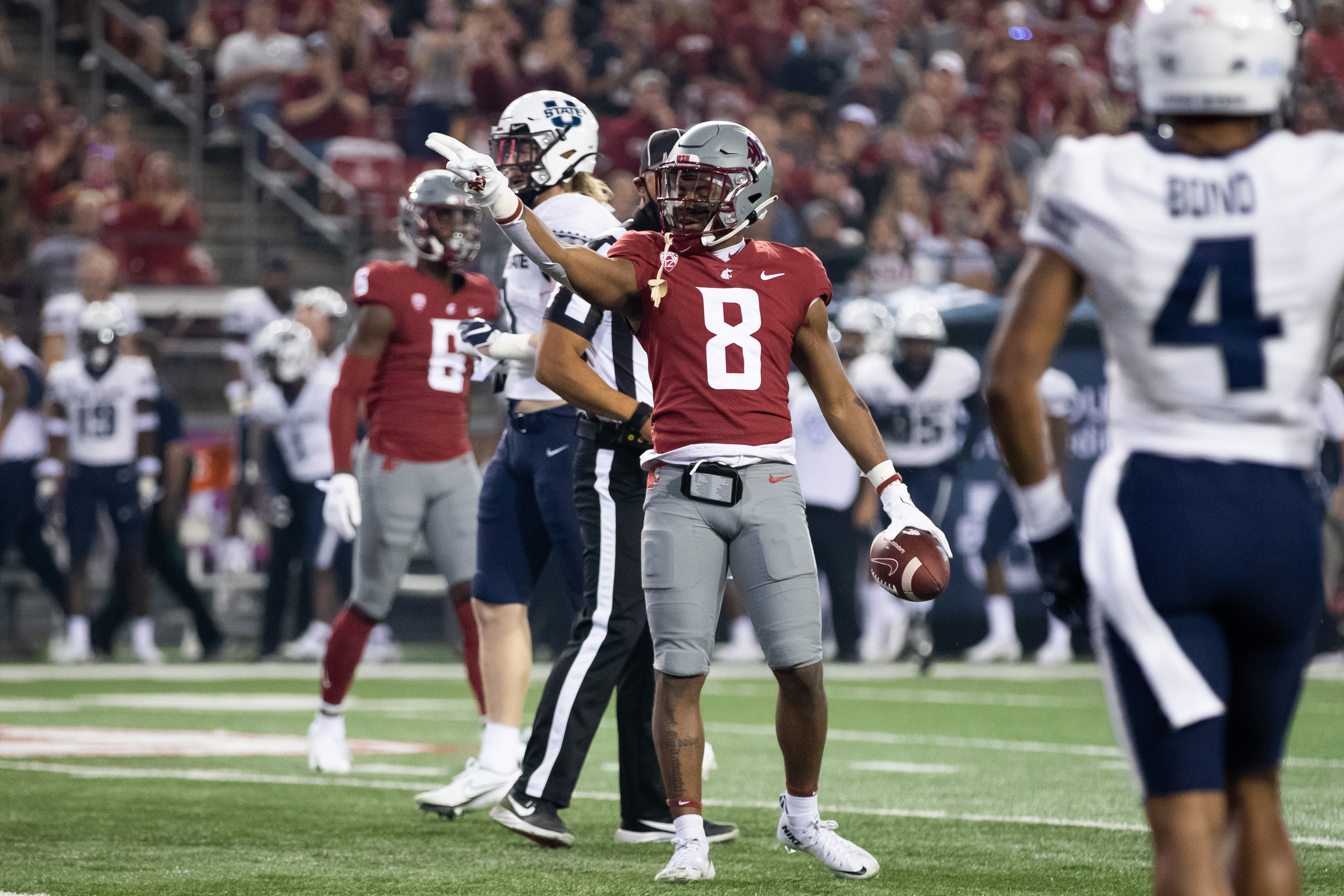 PULLMAN, WA - SEPTEMBER 4: Washington State wide receiver Calvin Jackson Jr (8) signals for a first down after a catch during the first half of a non-conference matchup between the Utah State Aggies and the Washington State Cougars on September 4, 2021, at Martin Stadium in Pullman, WA.