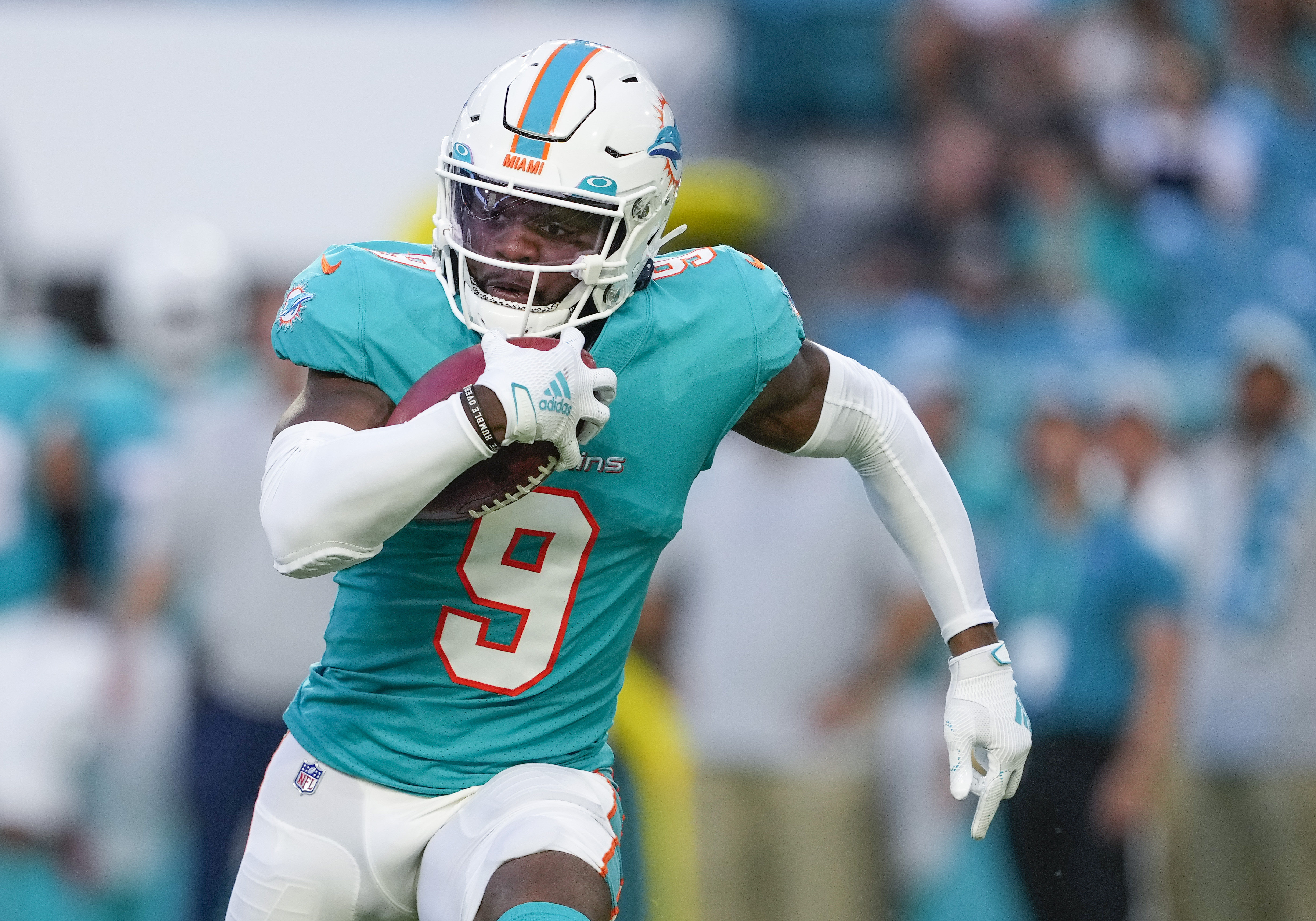 Miami Dolphins cornerback Noah Igbinoghene (9) runs with the ball for a first down during the NFL Football match between the Miami Dolphins and Atlanta Falcons on August 21, 2021 at Hard Rock Stadium in Miami, FL.